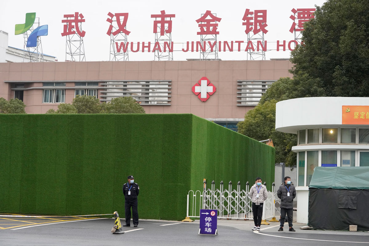 Security personnel guard an entrance to the Wuhan Jinyintan Hospital in China's Hubei province, where a team from the World Health Organization visited on January 30.