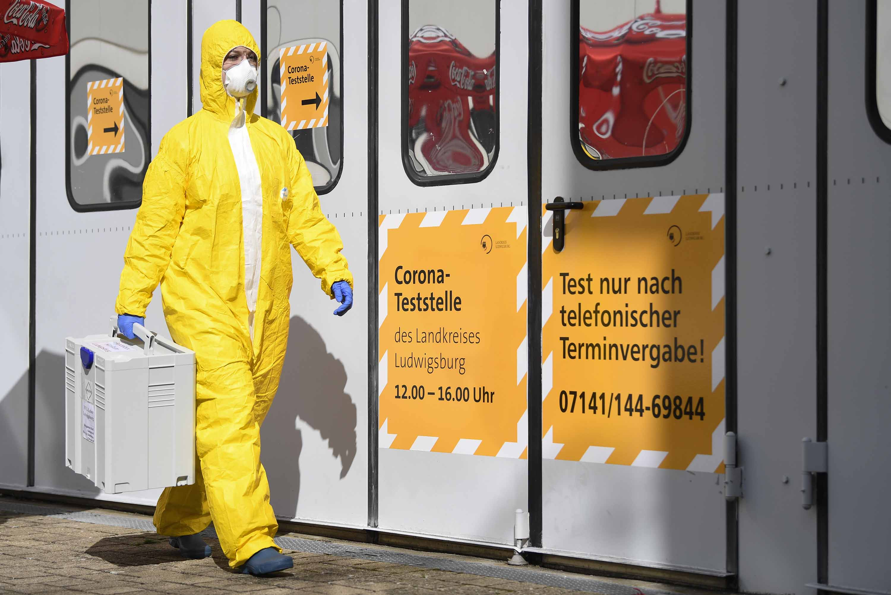 A staff member is seen at a coronavirus test center in Ludwigsburg, Germany, on March 14.