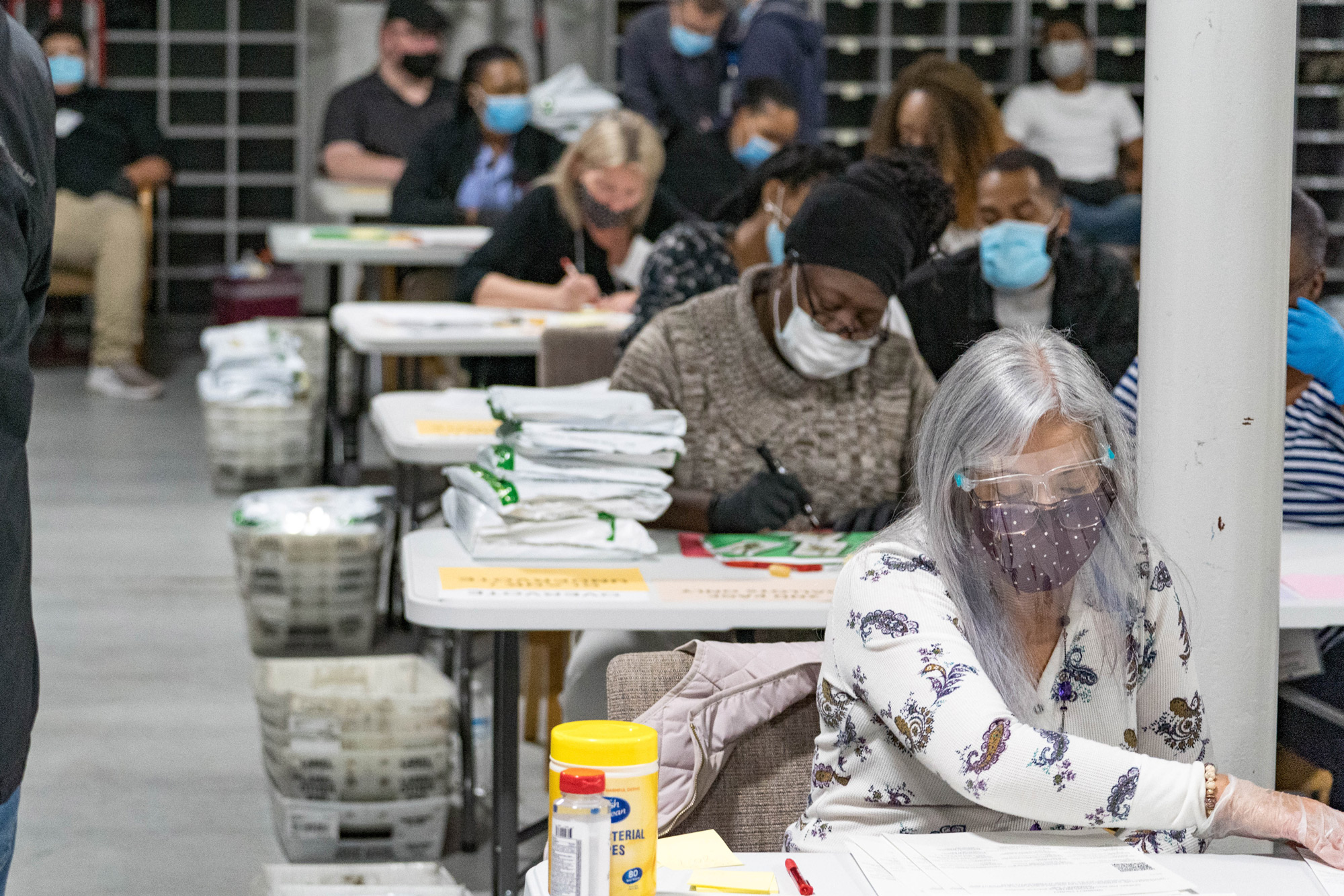 Gwinnett County election workers handle ballots as part of the recount for the 2020 presidential election at the Beauty P. Baldwin Voter Registrations and Elections Building on November 16 in Lawrenceville, Georgia.