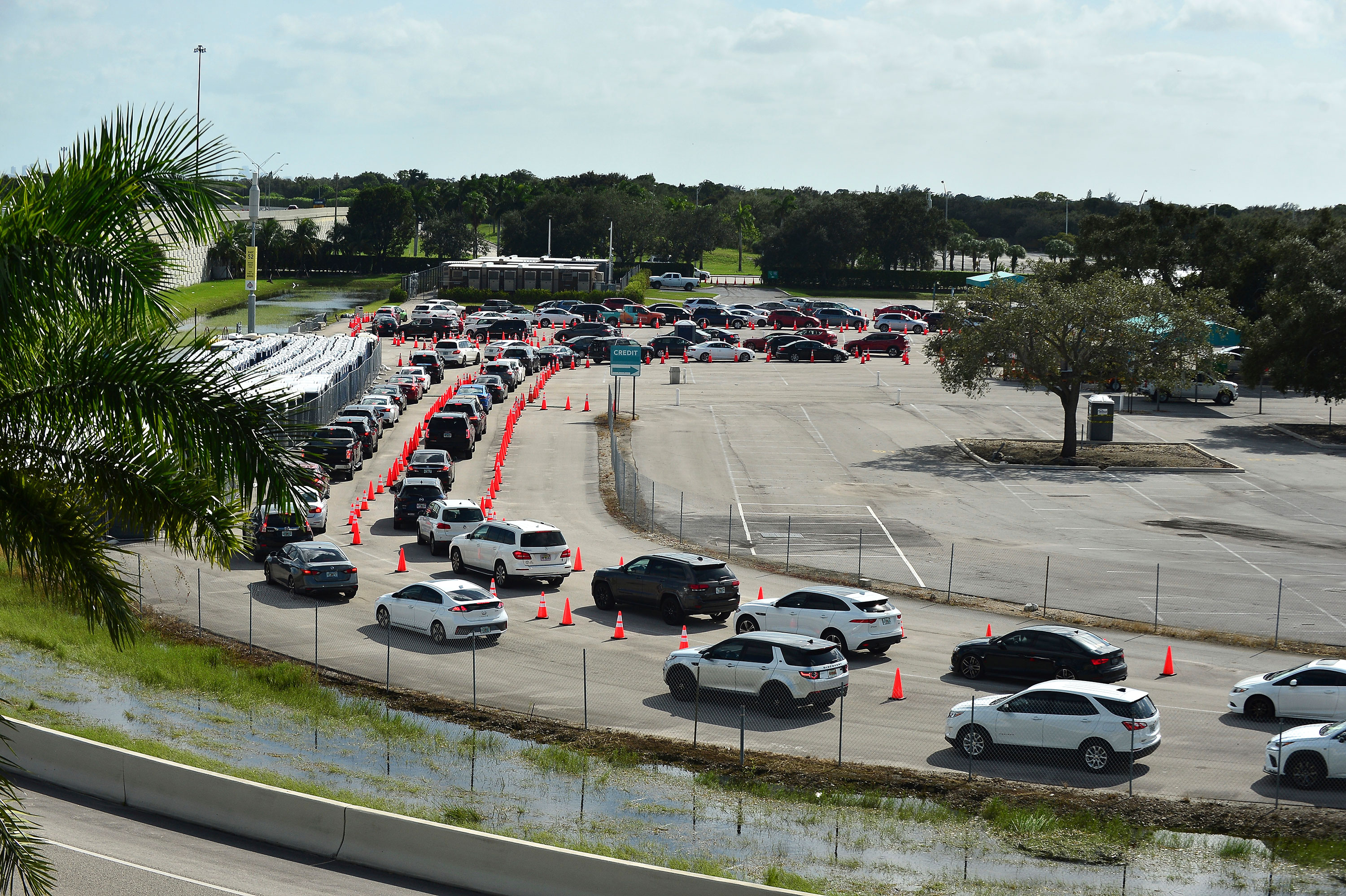Motorists wait in line at a drive-thru Covid-19 testing site on November 3 in Miami Gardens, Florida.
