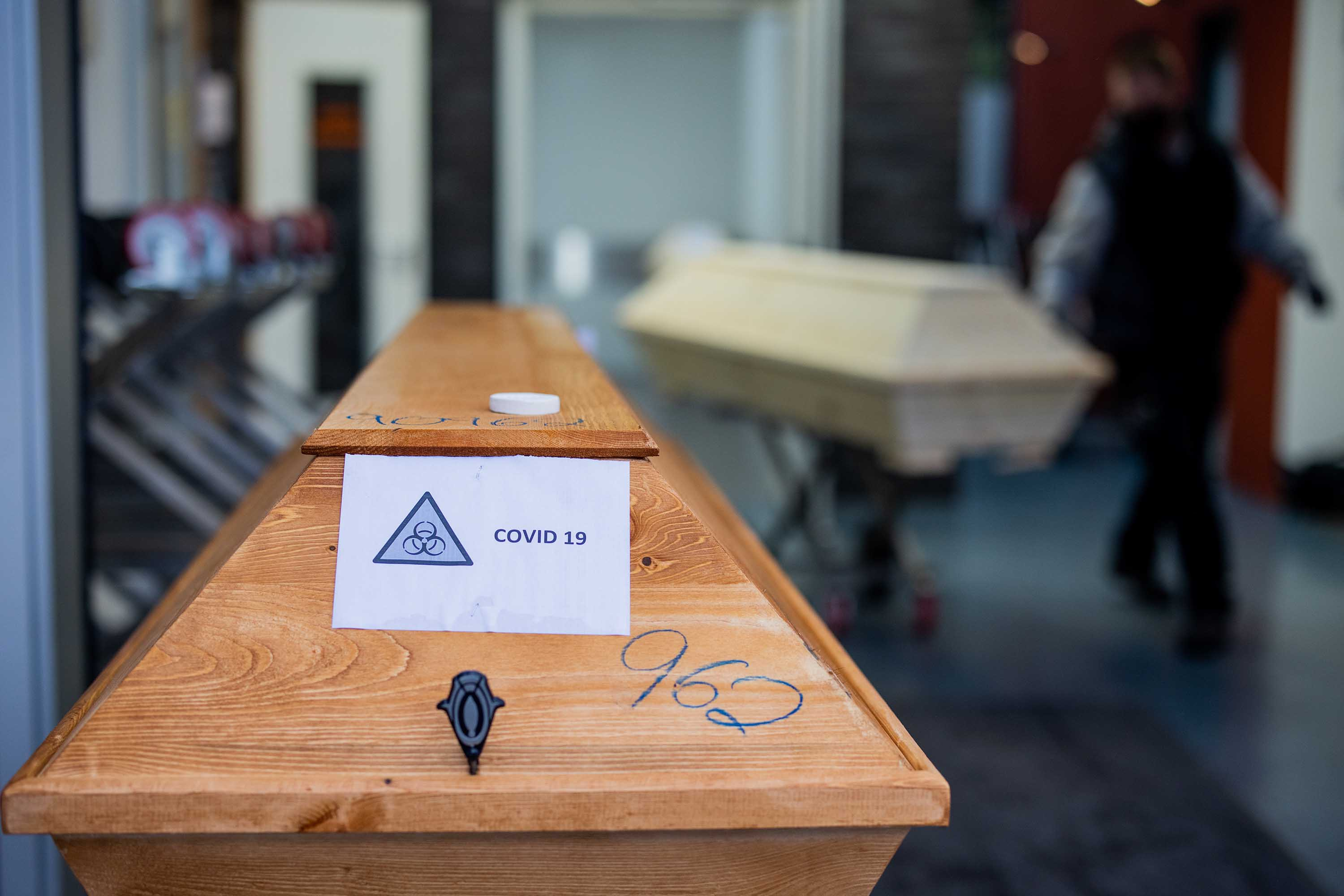 "A coffin labeled with the inscription ""Covid 19"" is pictured at a crematorium in Dülmen, Germany, on January 19."