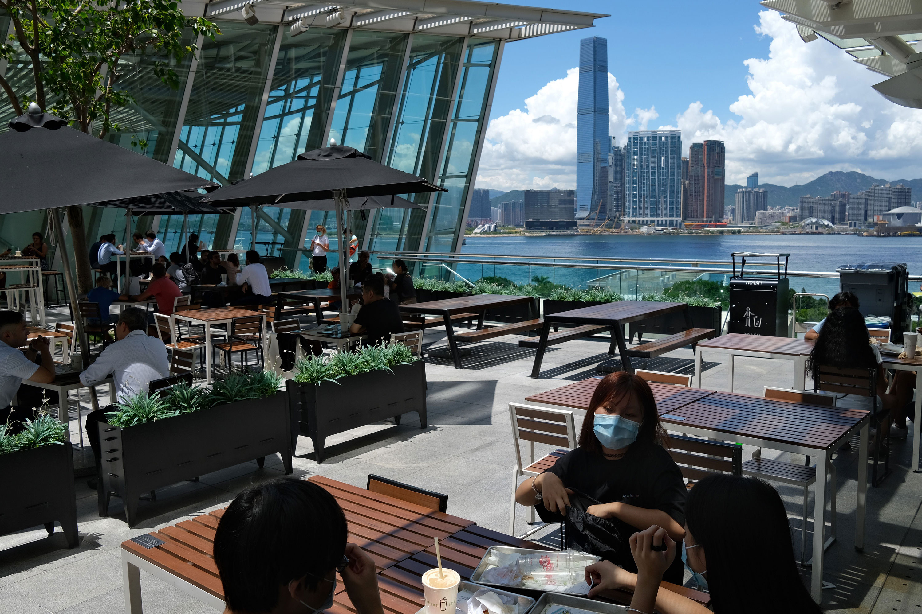 Customers have lunch at an outdoor dining area of a shopping mall on July 28 in Hong Kong.