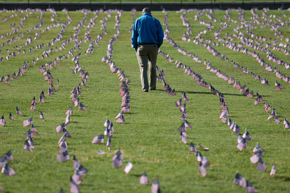 A man walks through a COVID Memorial Project installation on the grounds of the Washington Monument in Washington, DC on September 22.