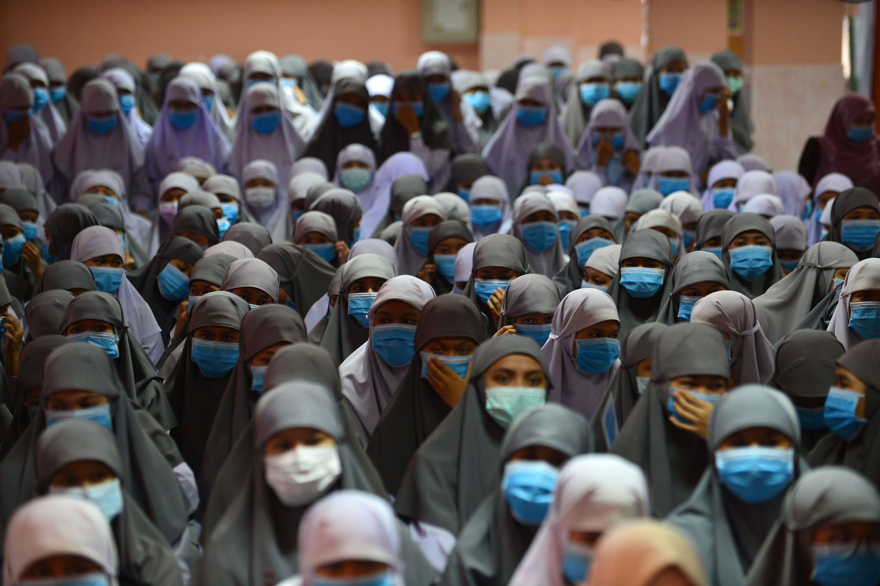 Students wear face masks during a ceremony at Attarkiah Islamic School in Narathiwat, Thailand on March 17.