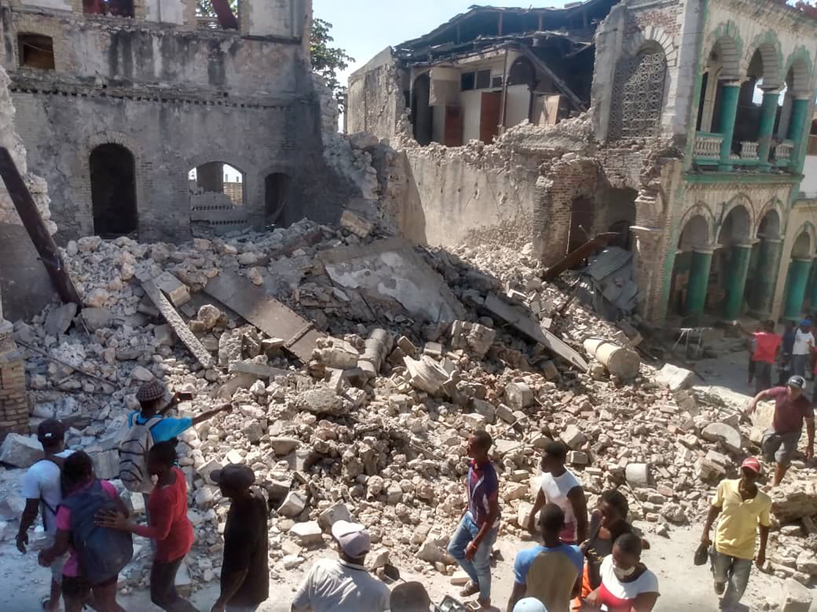 People inspect damaged buildings in Jeremie, Haiti, following a 7.2 magnitude earthquake struck the country on Aug. 14, 2021. The earthquake's epicenter was approximately 12 kilometers (7.5 miles) northeast of Saint-Louis-du-Sud, with a depth of 10 kilometers (6 miles).