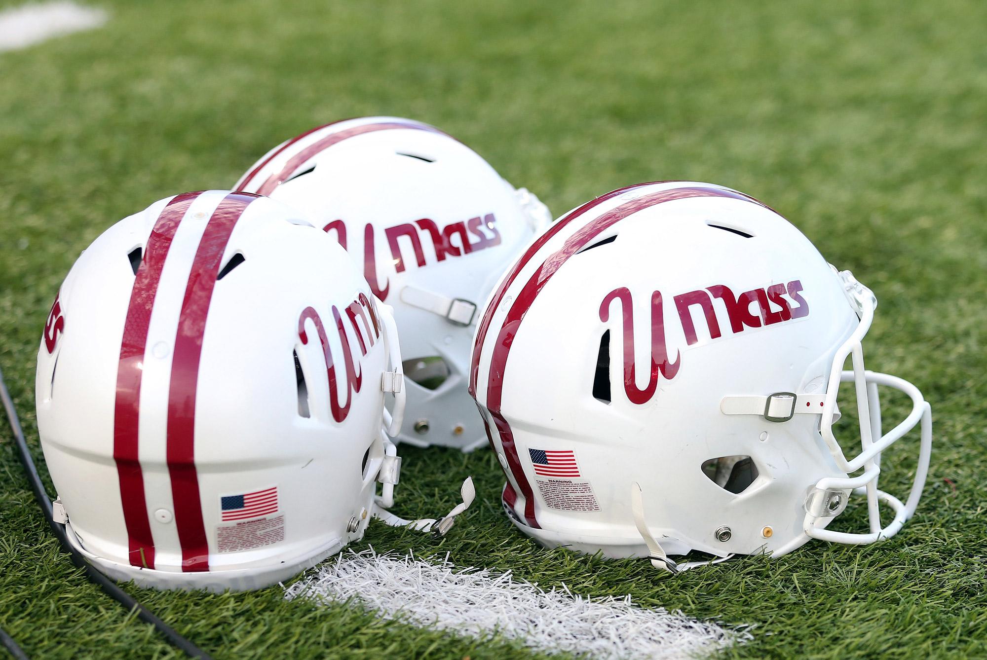 UMass Minutemen helmets sit on the ground on October 26, 2019, at Warren McGuirk Alumni Stadium in Amherst, Massachusetts.