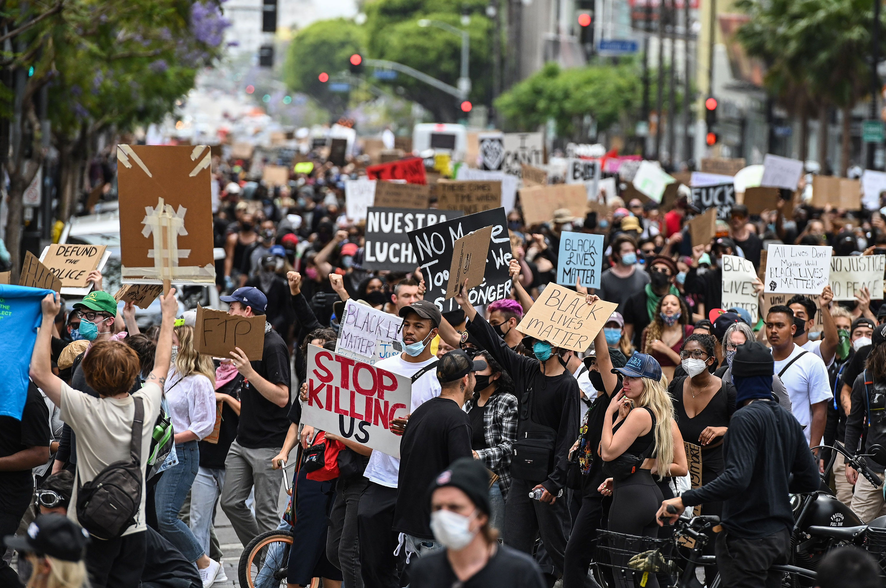 Demonstrators march through the streets on June 2 in Los Angeles.
