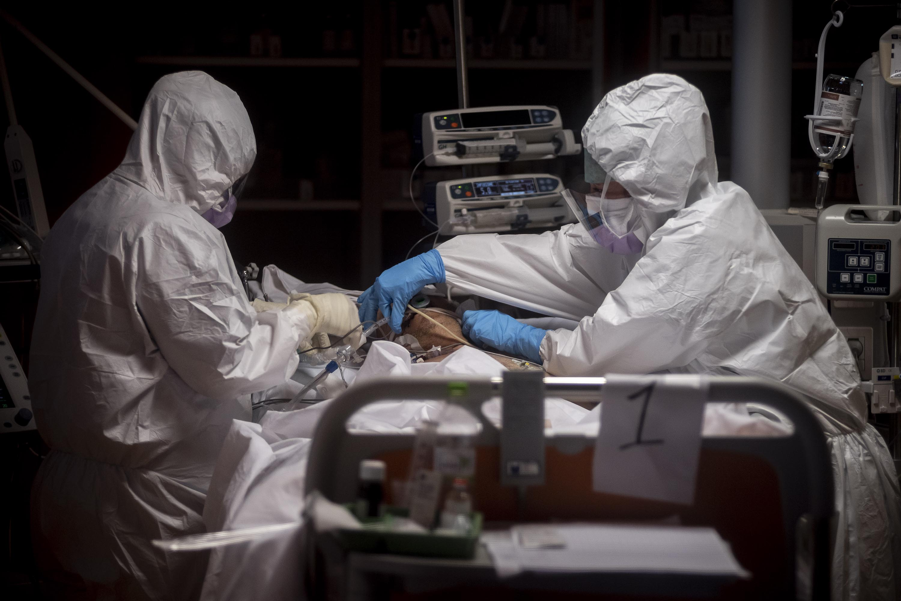 Doctors treat a coronavirus patient at a hospital in Rome, Italy, on March 26.
