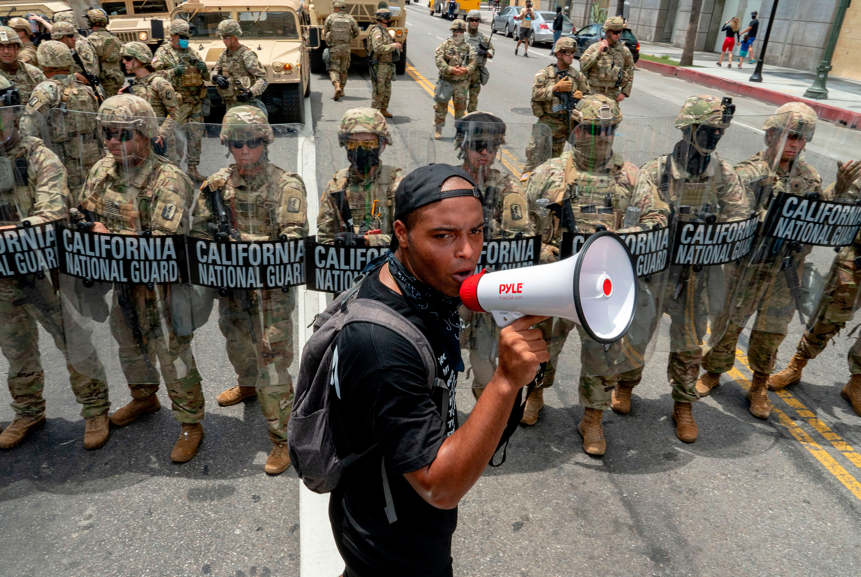 A protester speaks in front of the California National Guard on June 2 in Los Angeles, California.
