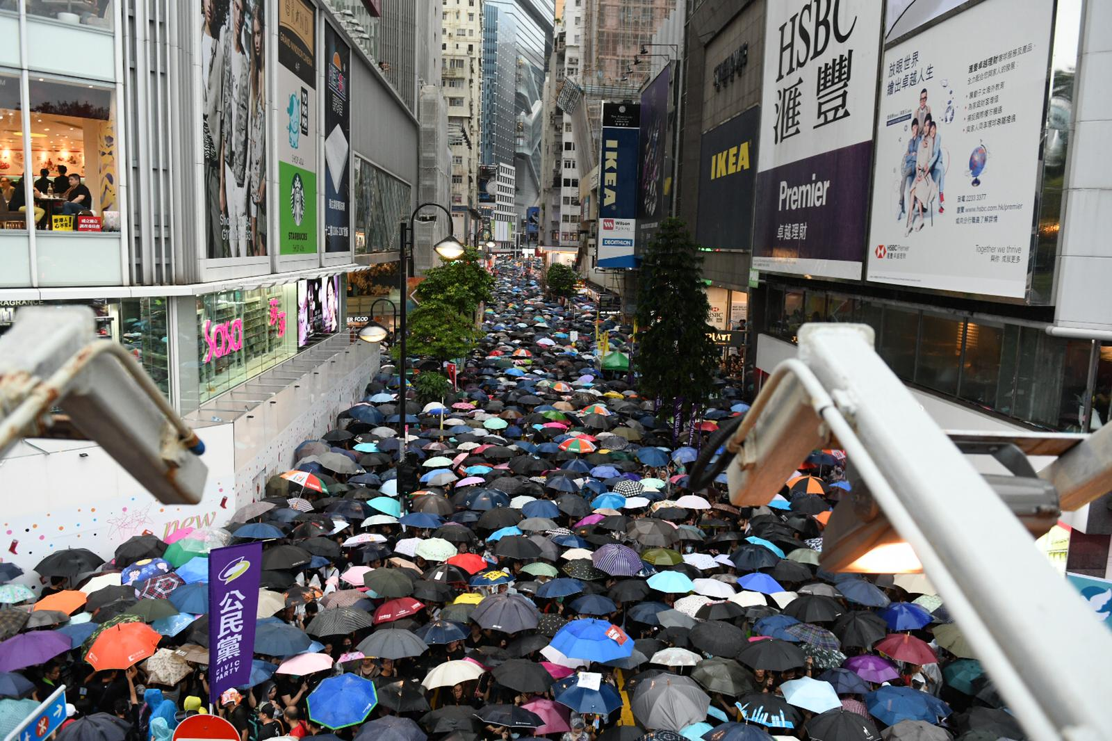 Protesters occupy the ramp to Glousester Highway, a major Hong Kong road.