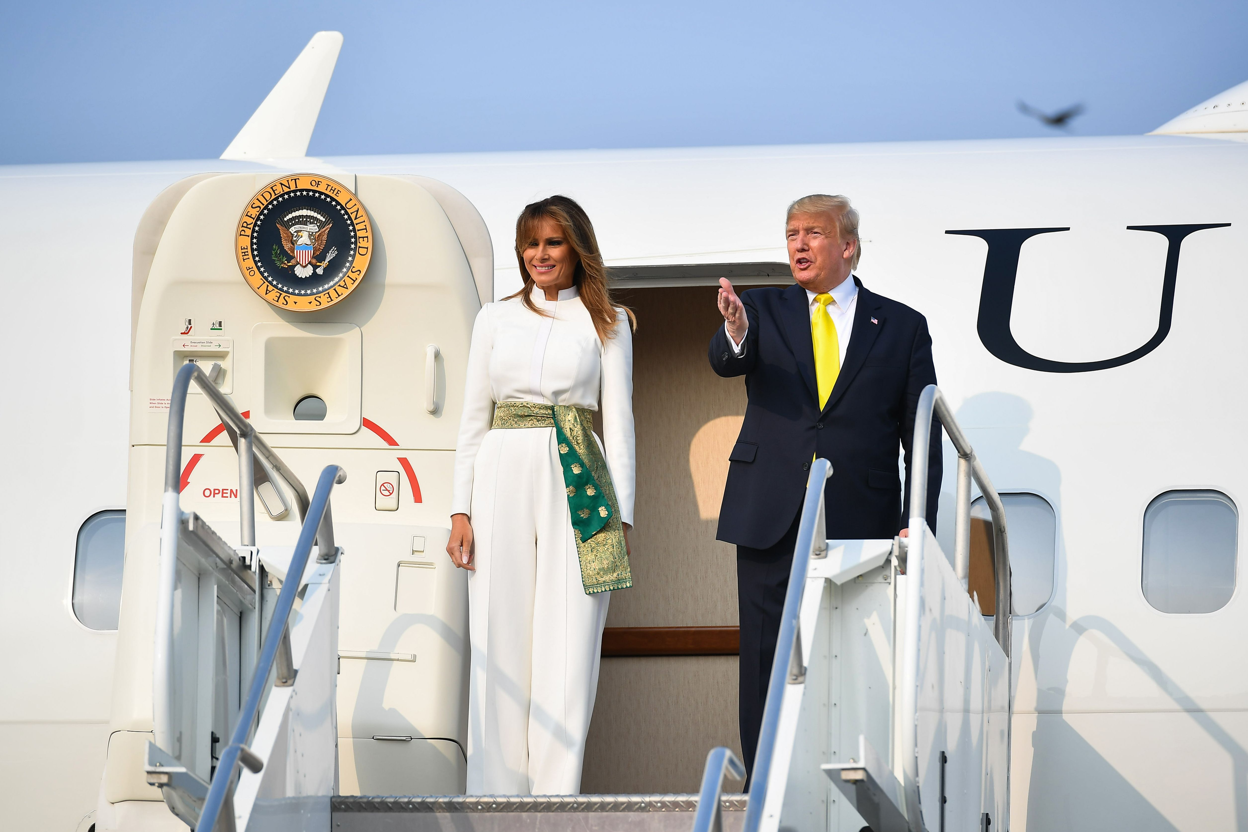 US President Donald Trump and first lady Melania Trump disembark from Air Force One upon their arrival at Agra Air Base on Monday.