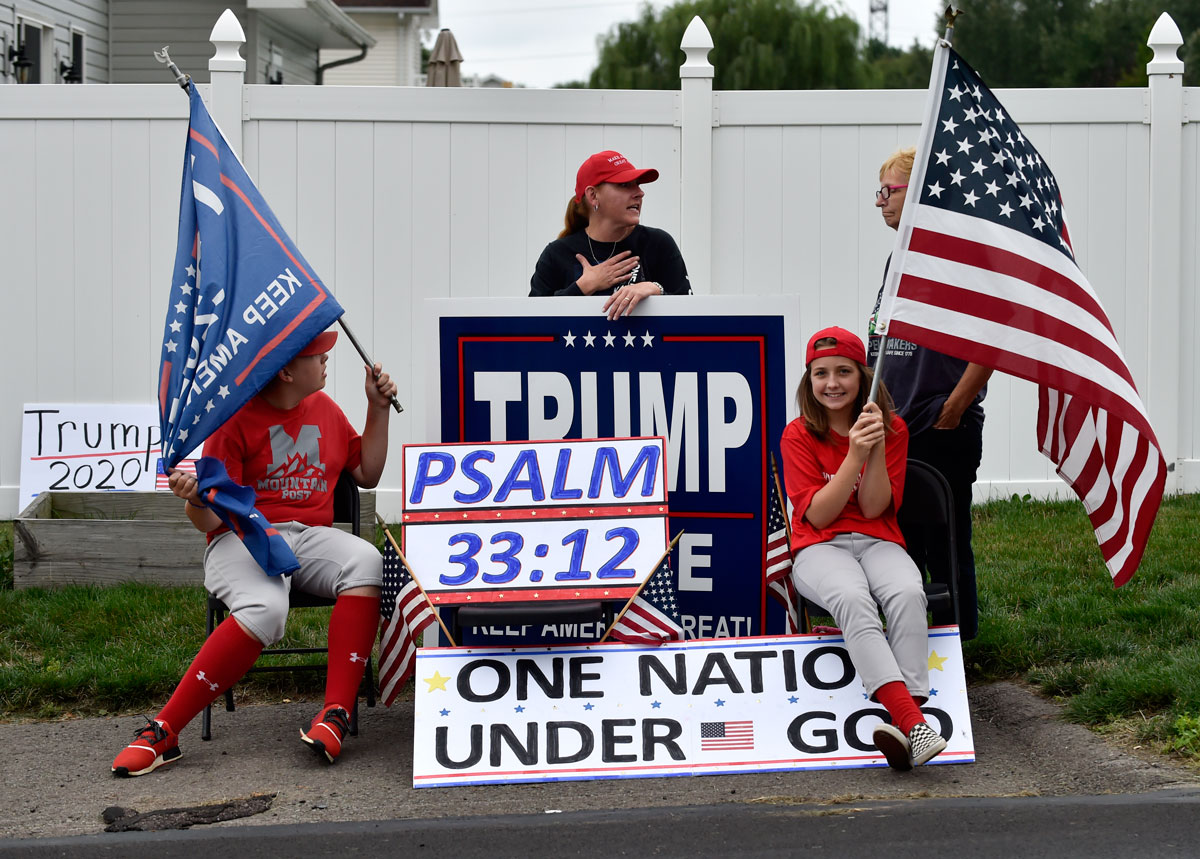 "Supporters of Mike Pence and Donald Trump wait for the Vice President's motorcade during a Sept. 1 ""Workers for Trump"" rally in Luzerne County, Pennsylvania."