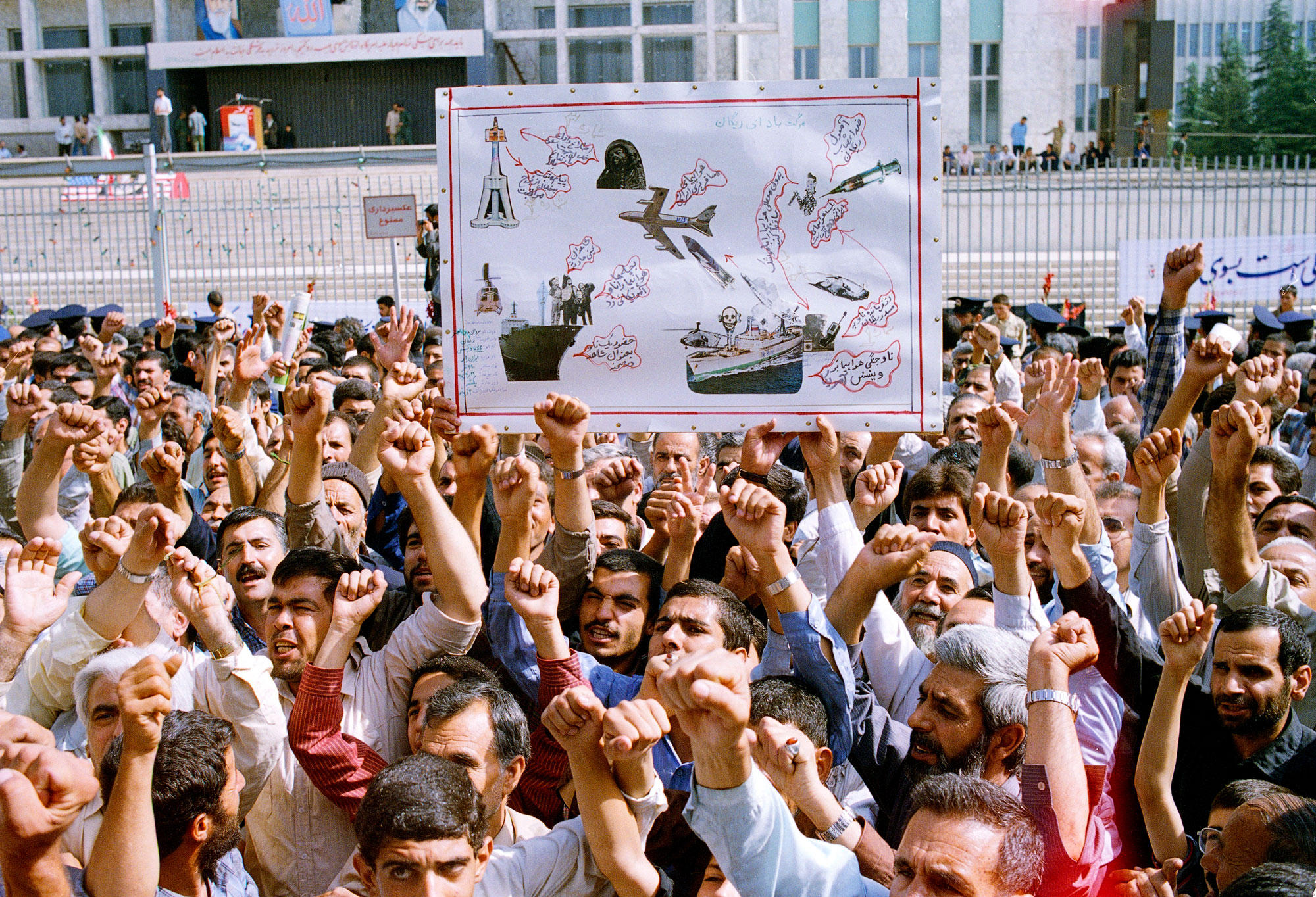 Thousands of Iranians participate in a mass funeral for 76 people killed when the USS Vincennes shot down Iran Air Flight 655 on July 7, 1988.