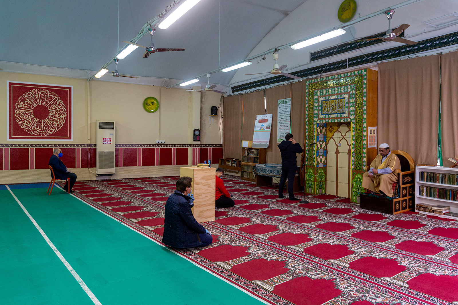 An imam holds the Friday sermon during Ramadan in a near empty mosque in Milan, Italy on May 1.