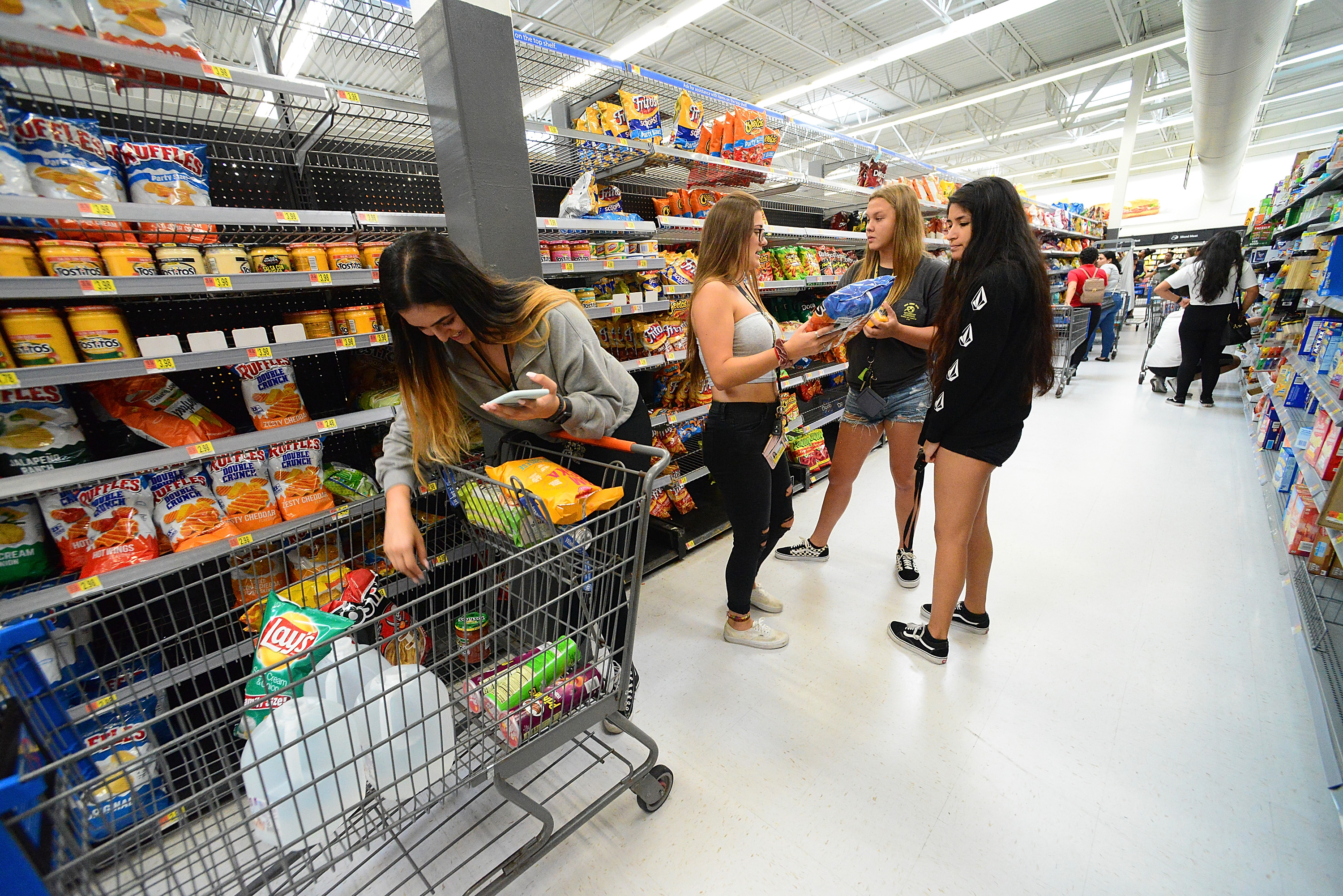 University of Central Florida students buy groceries at a Wal-Mart Super Store in preparation for Hurricane Dorian.