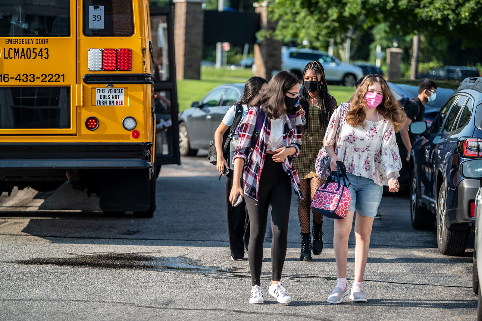Students return to class on the first day of school at the Jericho, New York school district on August 26, 2021.