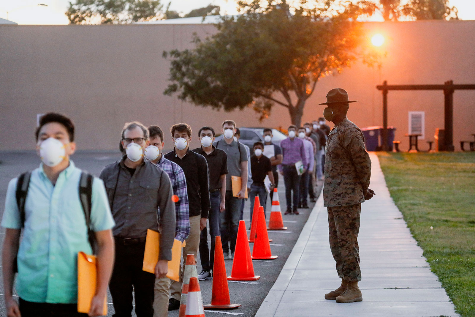 US Marine Corps recruits wait in line for health screenings at the Marine Corps Recruit Depot in San Diego, California.