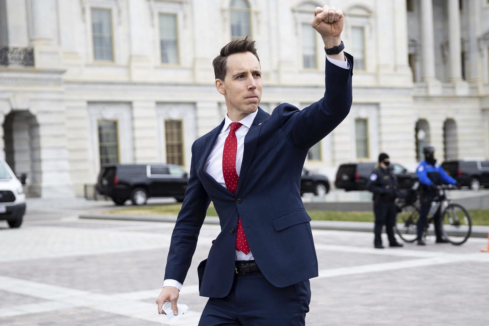 Sen. Josh Hawley gestures toward a crowd of supporters of President Donald Trump gathered outside the U.S. Capitol to protest the certification of President-elect Joe Biden's electoral college victory on January 6 in Washington.