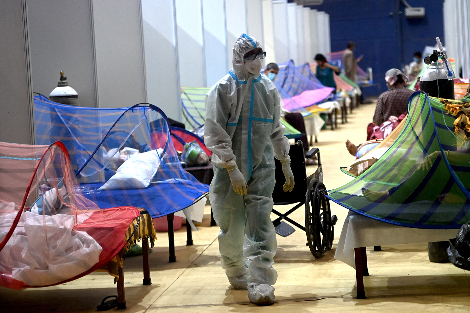 A health worker walks inside the Commonwealth Games stadium temporarily converted into a Covid-19 care center in New Delhi, India, on May 5.