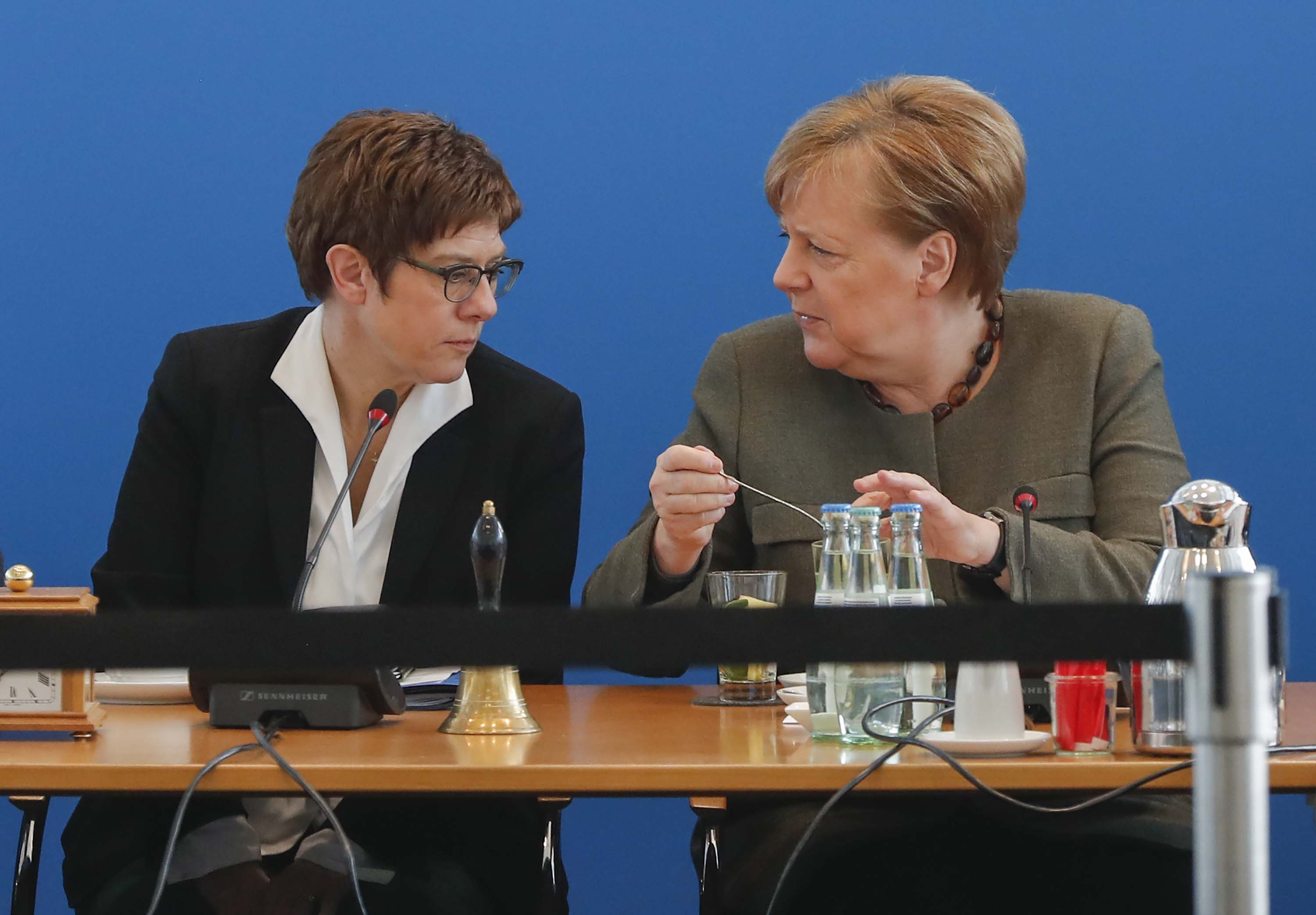 The leader of the Christian Democratic Union (CDU) Annegret Kramp-Karrenbauer, left, speaks with German Chancellor Angela Merkel, prior to a party leadership meeting on February 24, in Berlin, Germany.