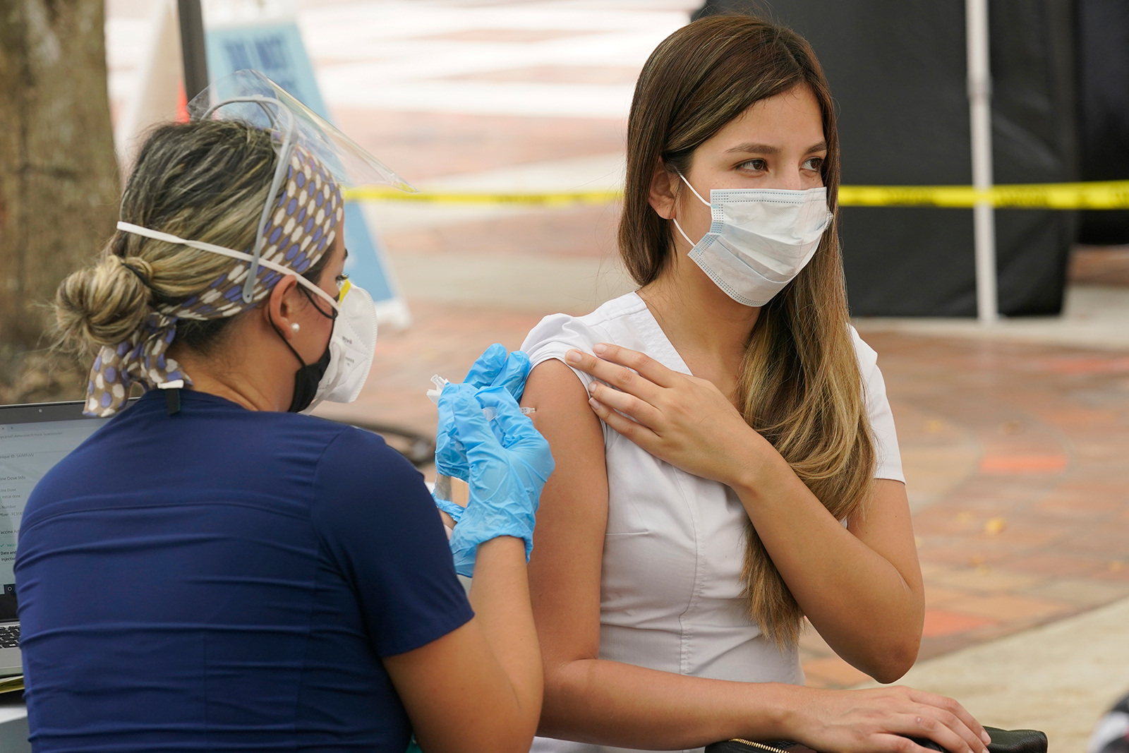Maria Oramas gets the first dose of the Pzifer Covid-19 vaccine on Monday, August 9, in Miami.