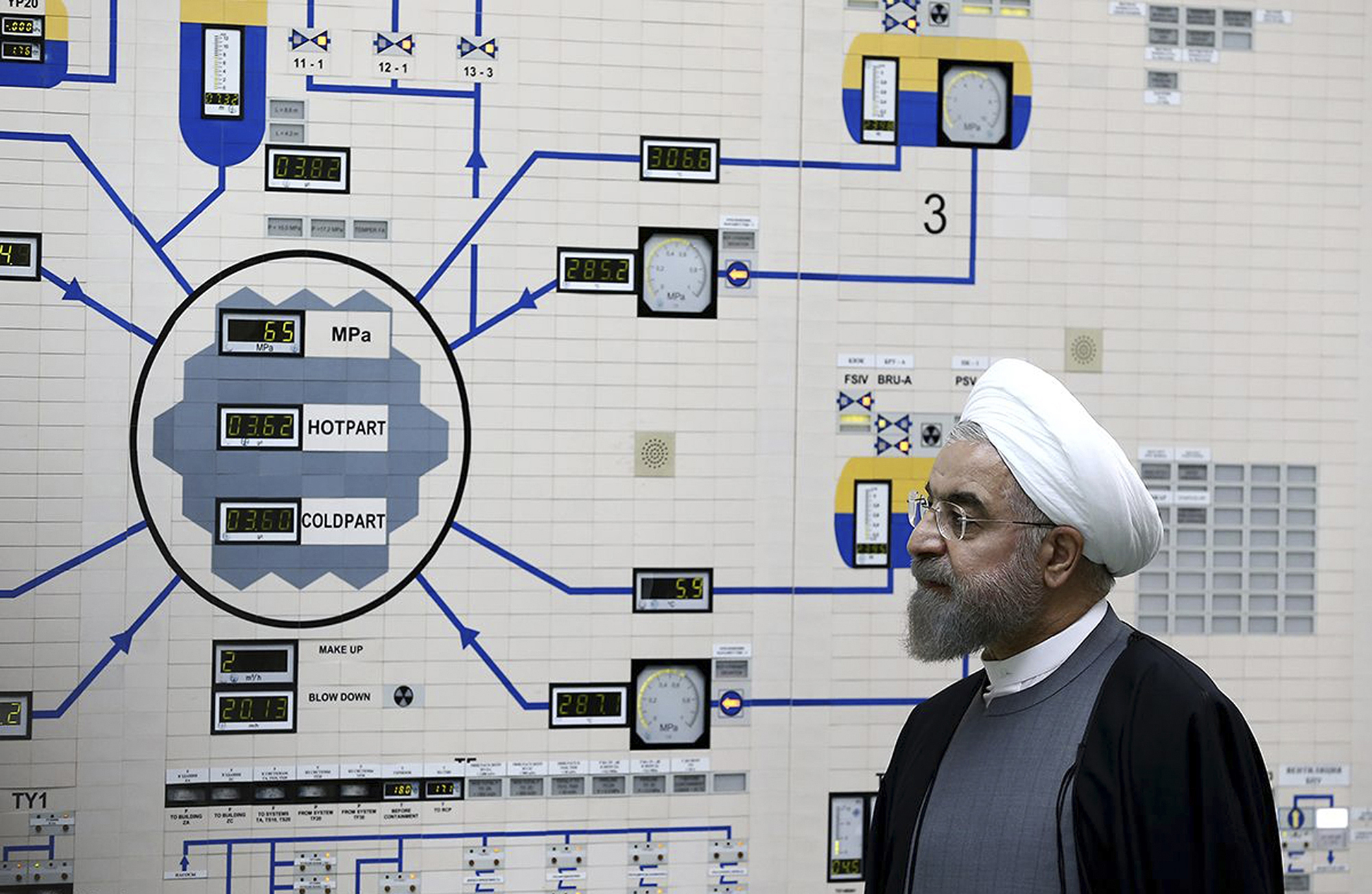 In this file photo from January 13, 2015, released by the Iranian President's Office, President Hassan Rouhani visits the Bushehr nuclear power plant just outside of Bushehr, Iran.