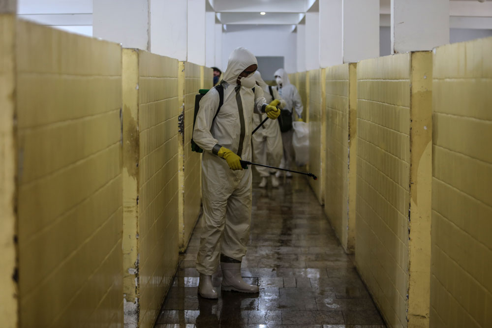 Members of the military clean at at a health clinic in Sao Goncalo, Brazil on Wednesday.