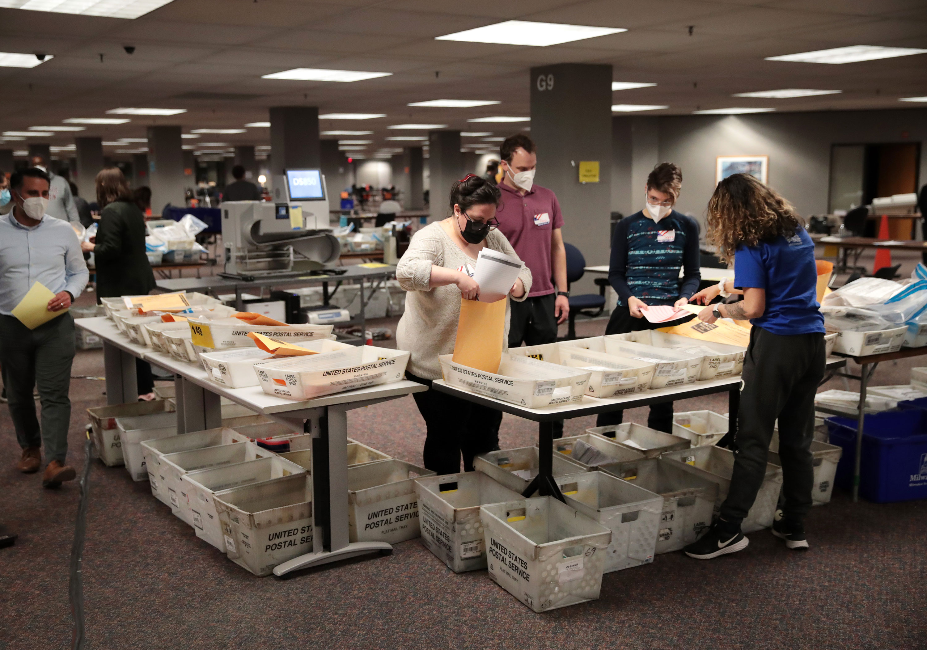 Election officials count absentee ballots on November 4 in Milwaukee, Wisconsin.