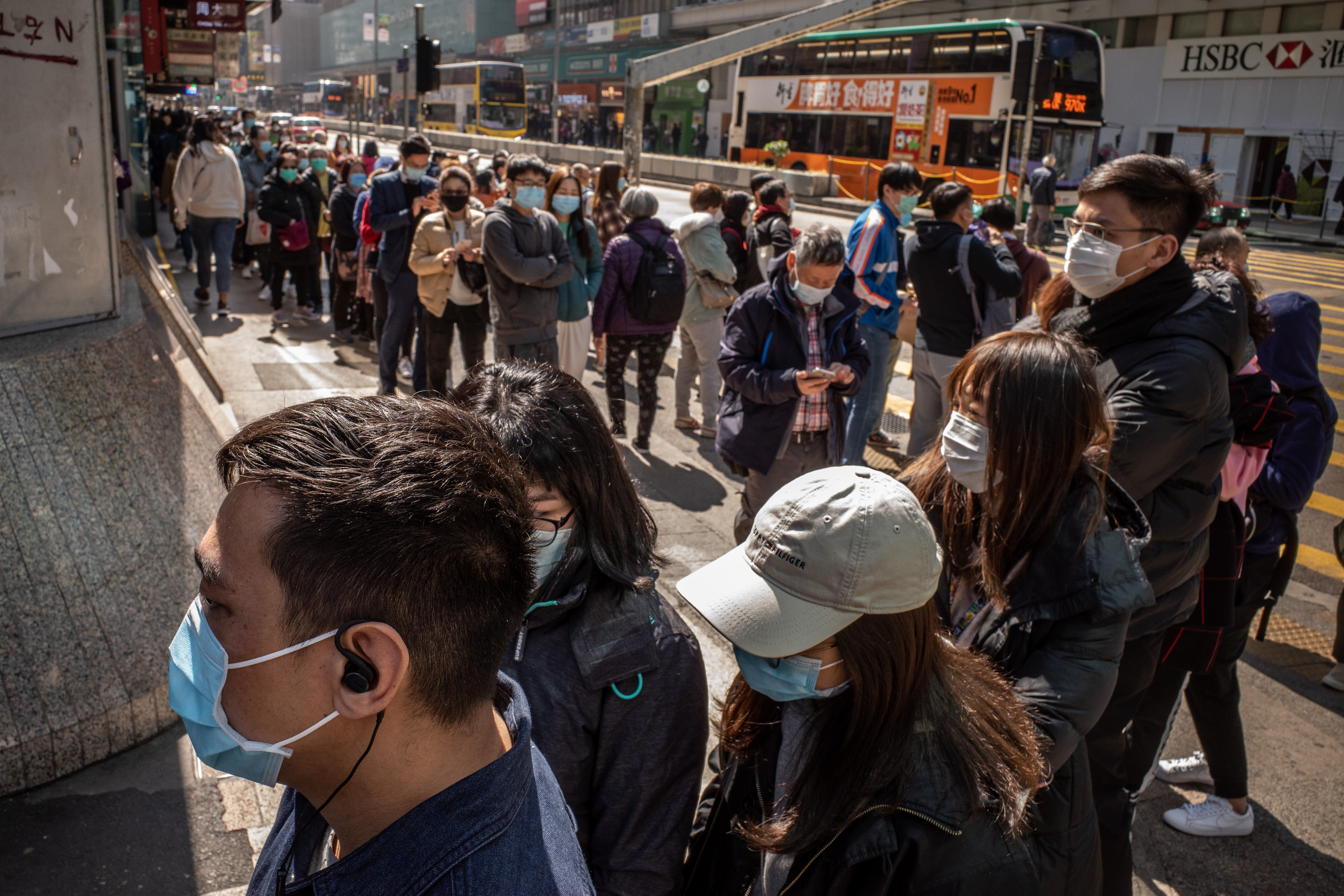 Hong Kong residents line up to buy face mask at a pharmacy on January 31, 2020.