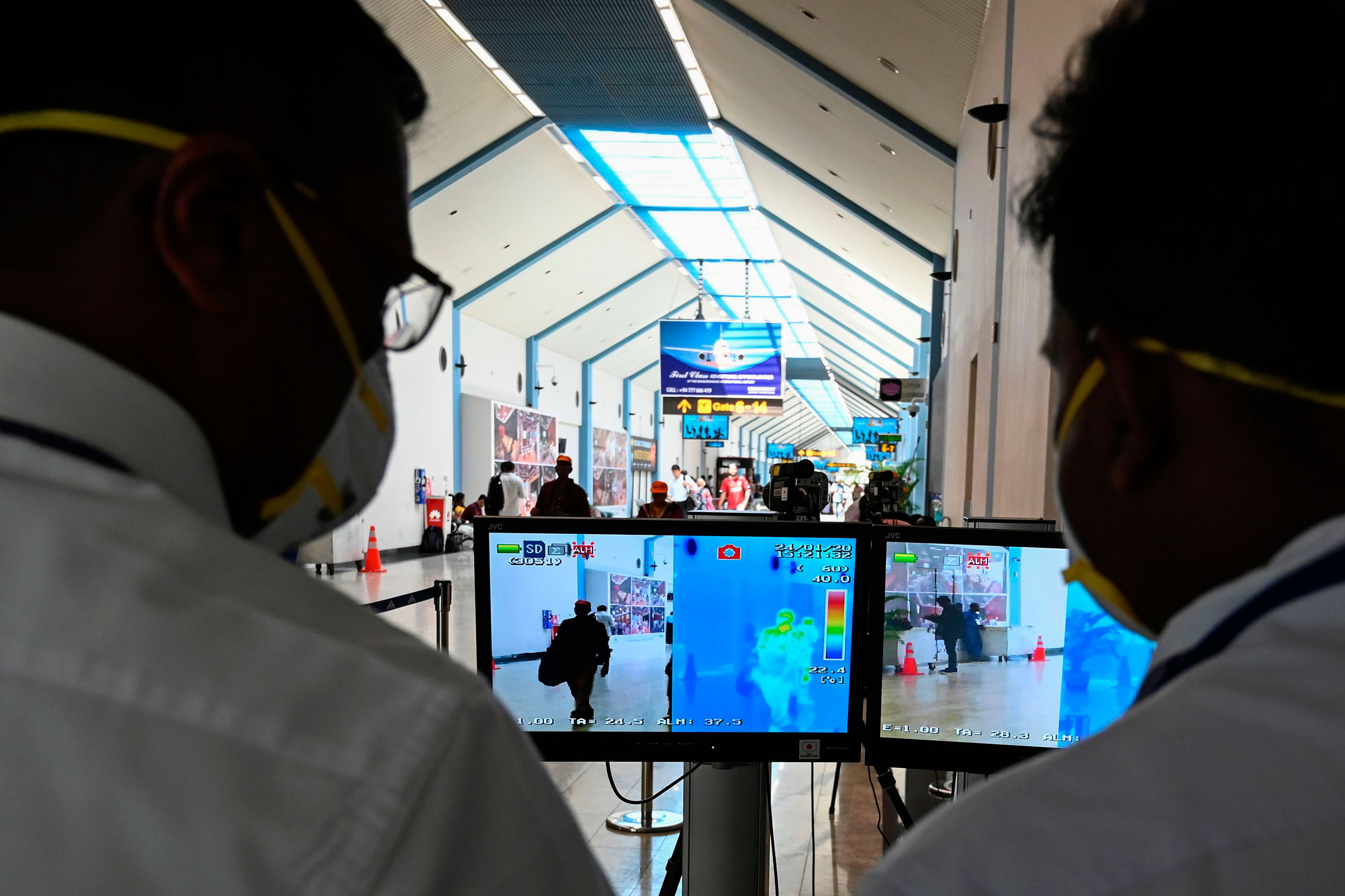 Airport employees monitor screens of a thermal scanner to check body temperature of arriving passengers, at Bandaranaike International airport in Katunayake, Sri Lanka on January 24.