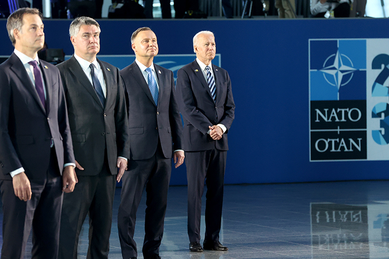 From left, Belgium's Prime Minister Alexander De Croo, Croatia's President Zoran Milanovic, Poland's President Andrzej Duda and U.S. President Joe Biden pose during a group photo at a NATO summit in Brussels, Monday, June 14, 2021.