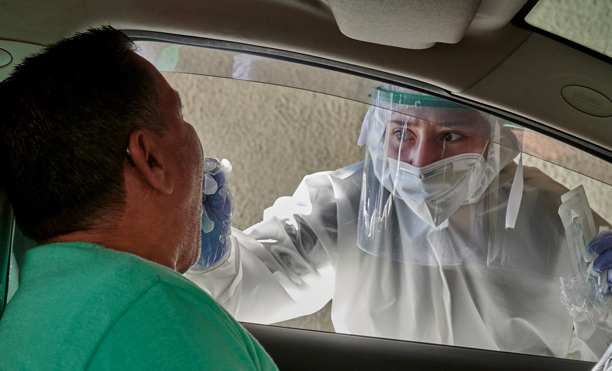 A health technician takes a sample from a driver at a Portuguese Red Cross COVID-19 Testing Post in Lar Militar on October 16 in Lisbon, Portugal.