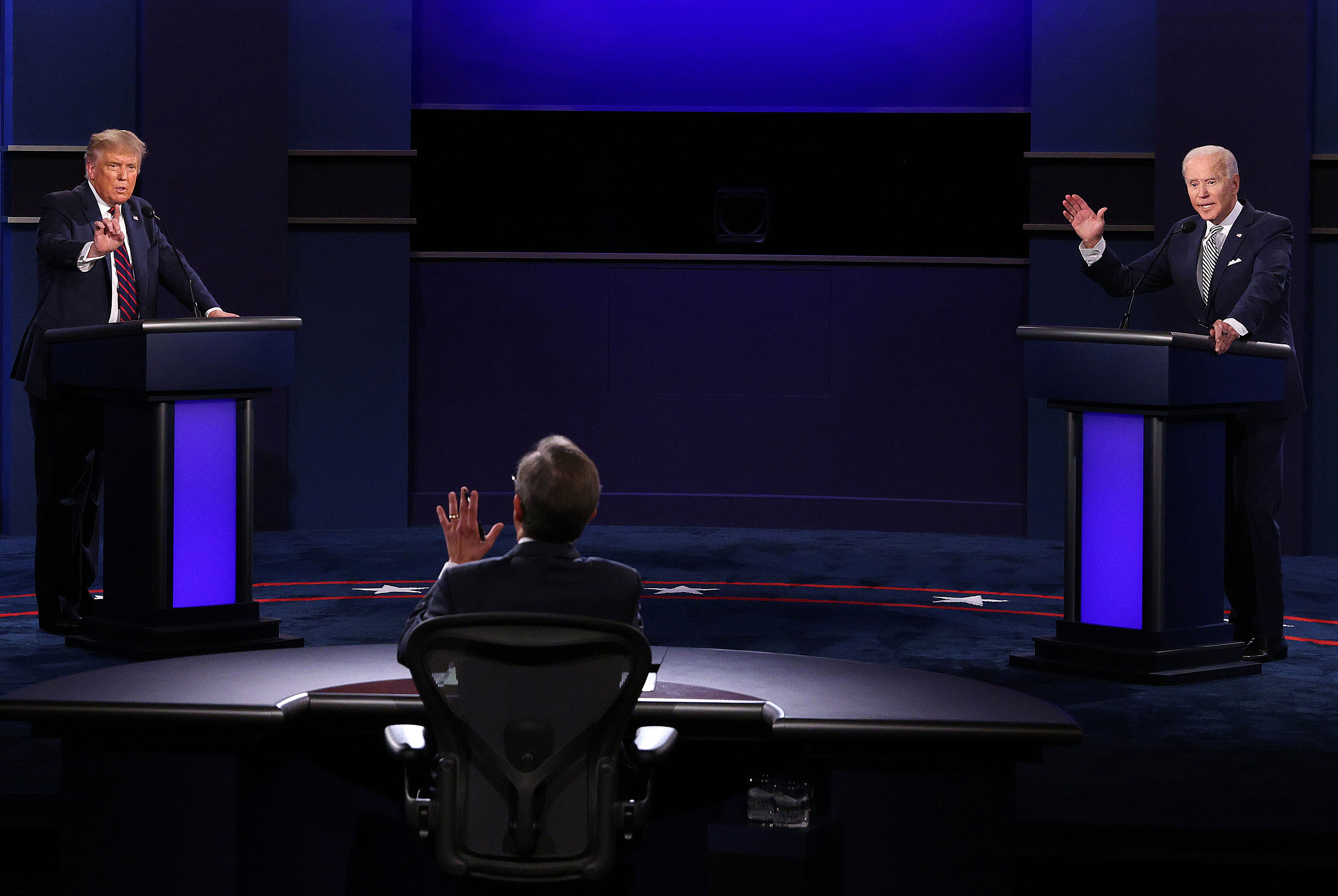 President Donald Trump, left, and Democratic nominee Joe Biden take part in the first presidential debate on September 29 in Cleveland. At center is moderator Chris Wallace.