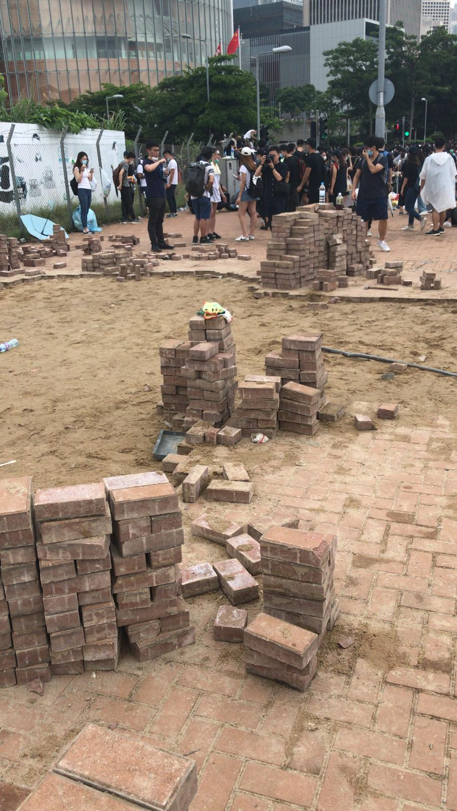 Hong Kong protesters dig up bricks from the pavements.