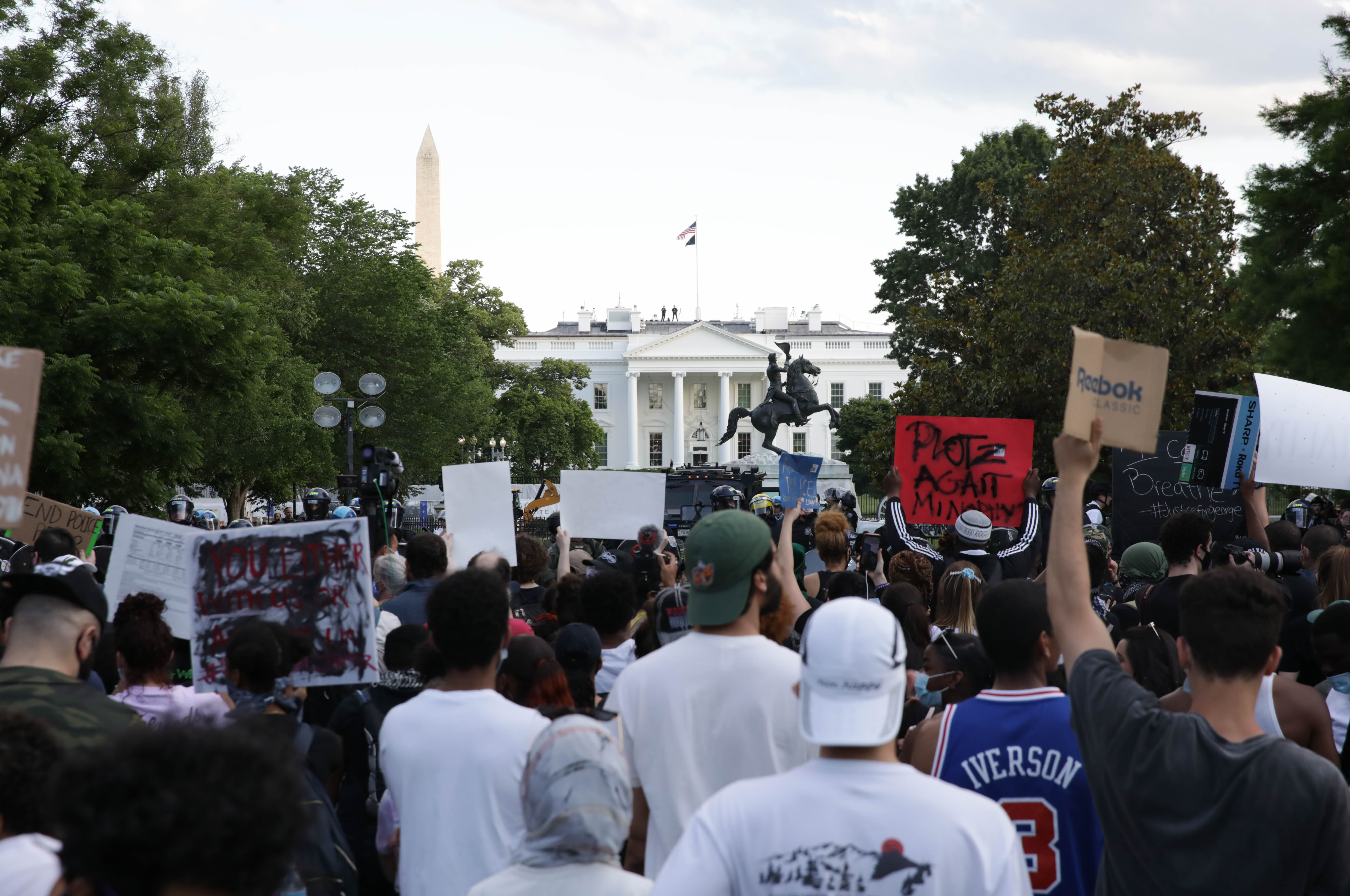Demonstrators gather at Lafayette Park across from the White House on May 30.