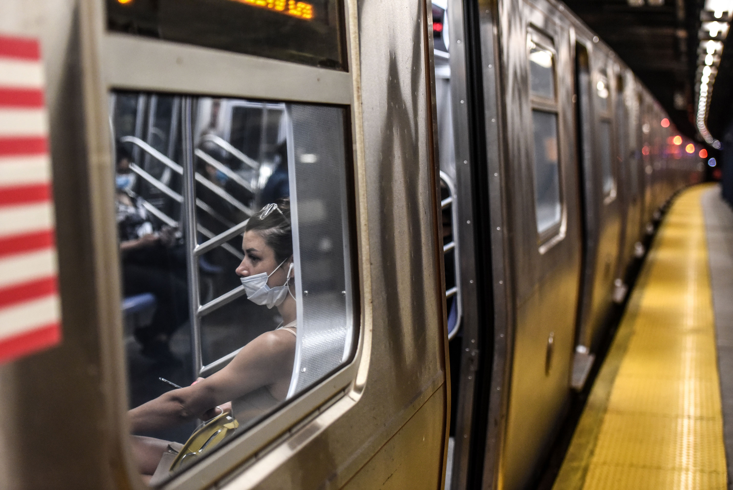 A person commutes on the subway in Brooklyn on June 22.