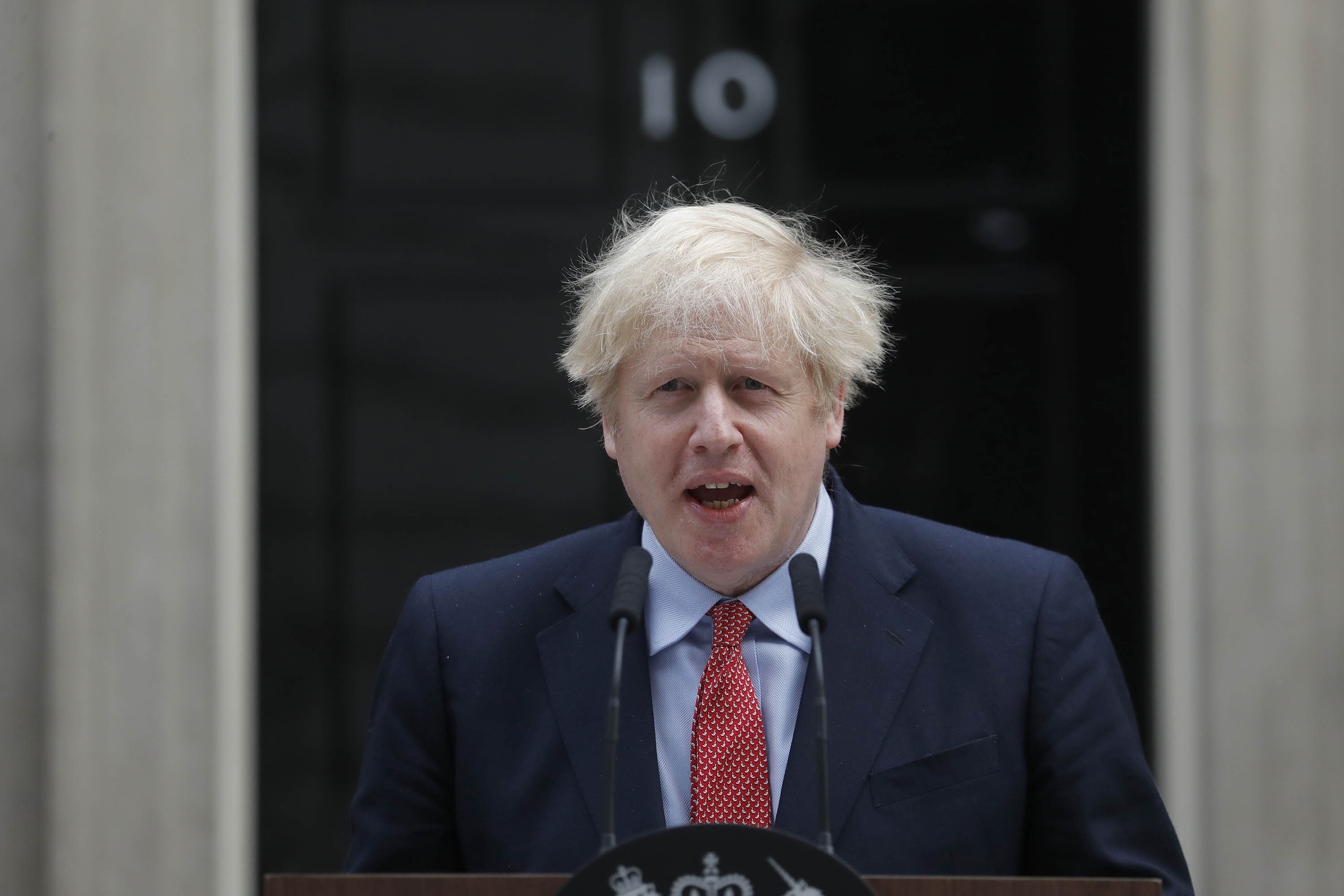 British Prime Minister Boris Johnson makes a statement at 10 Downing Street in London on Monday, April 27, his first day back at work after recovering from Covid-19.