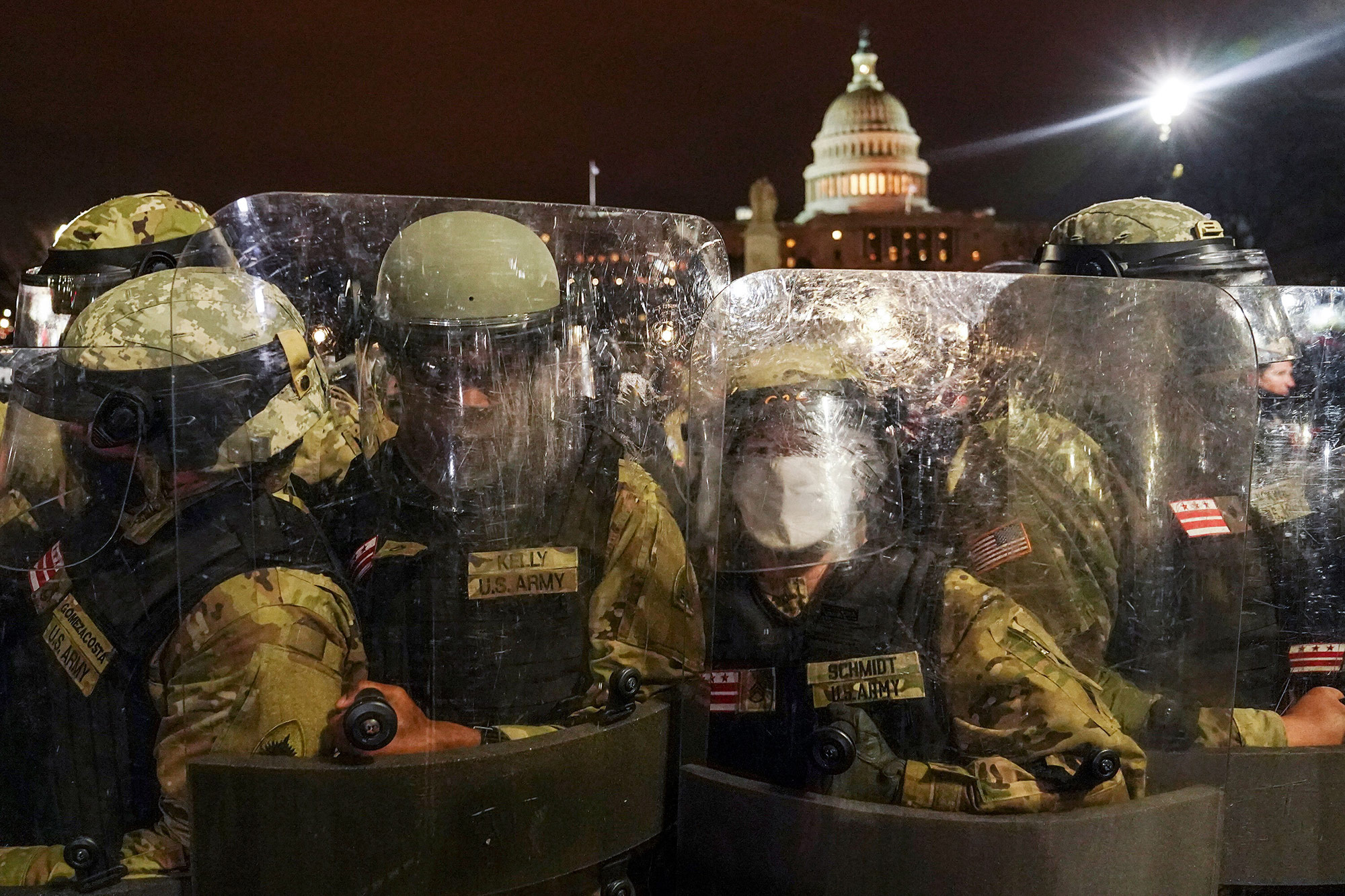 DC National Guard stand outside the Capitol on Wednesday, January 6.