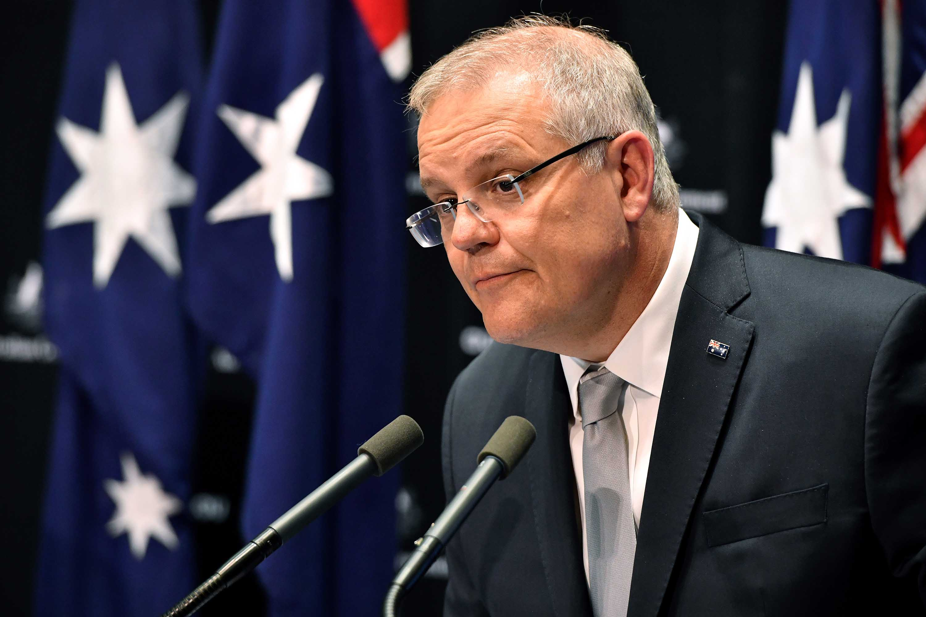 Australian Prime Minister Scott Morrison attends a news conference at Parliament House in Canberra, Australia, on Thursday.