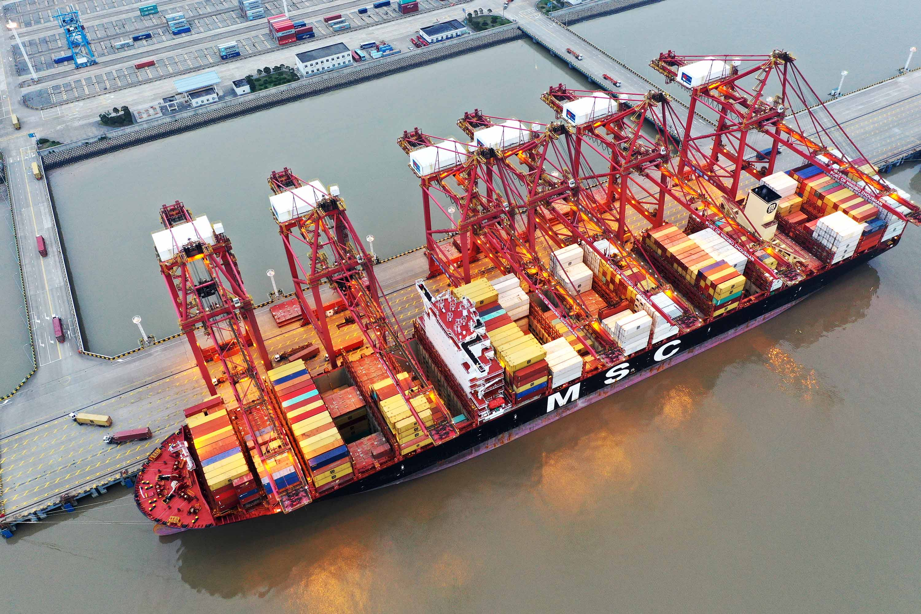 Containers sit stacked on a cargo ship berthed at Zhoushan Port in China, on February 4.