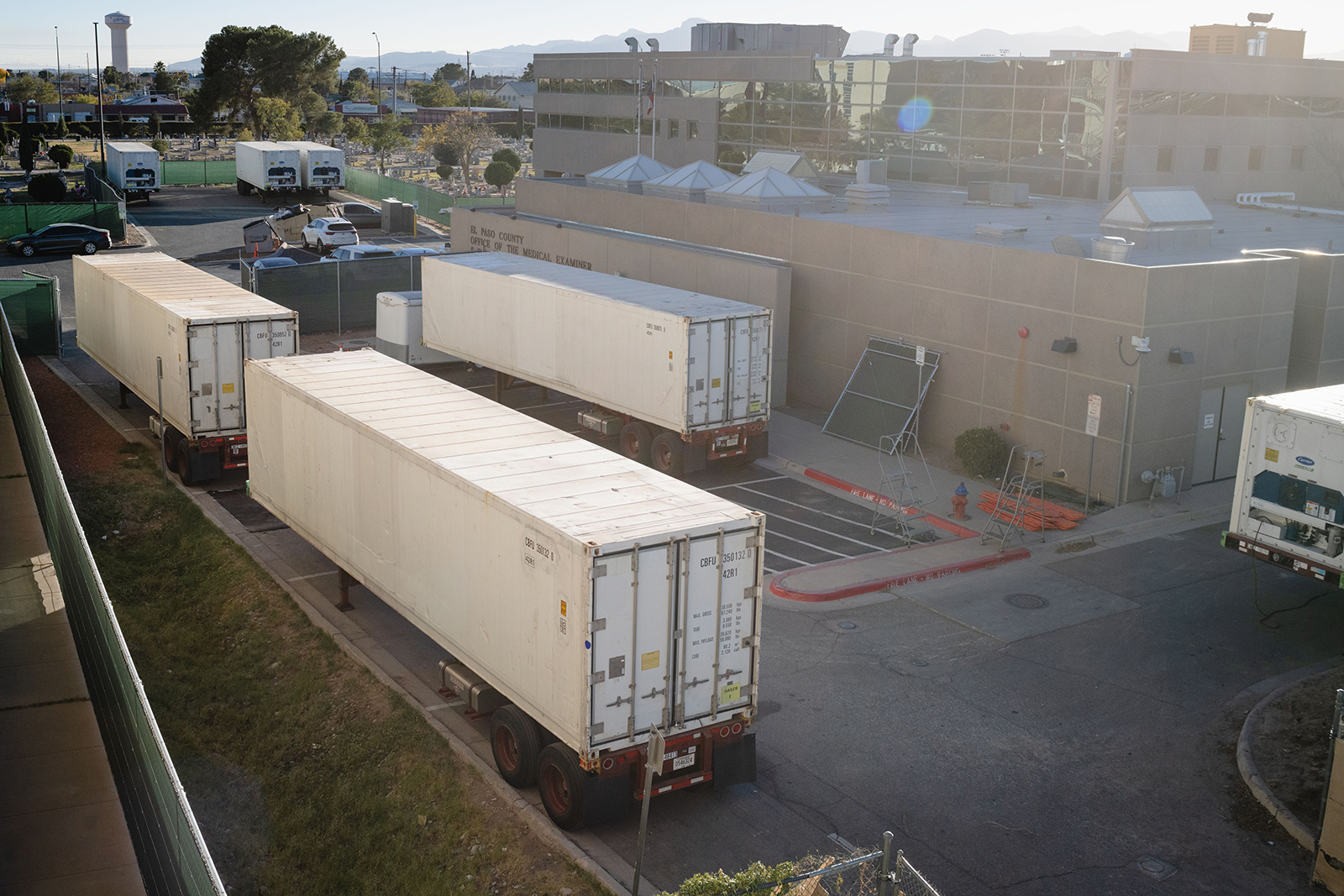 Refrigerated trailers serving as makeshift morgues are pictured outside of the El Paso County Medical Examiner's office in El Paso, Texas, on November 16.