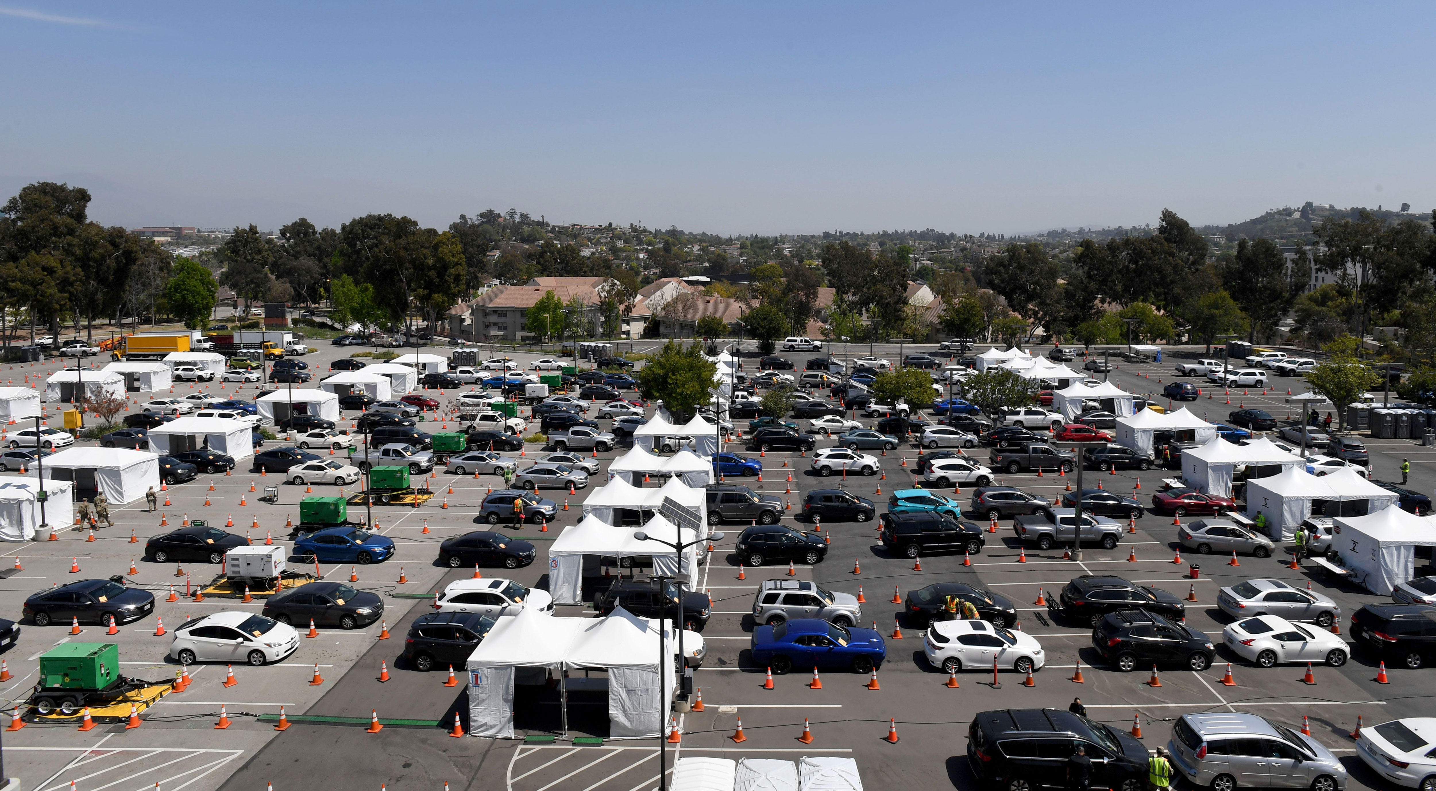 People in cars line up for Covid-19 vaccinations in Los Angeles on April 8.