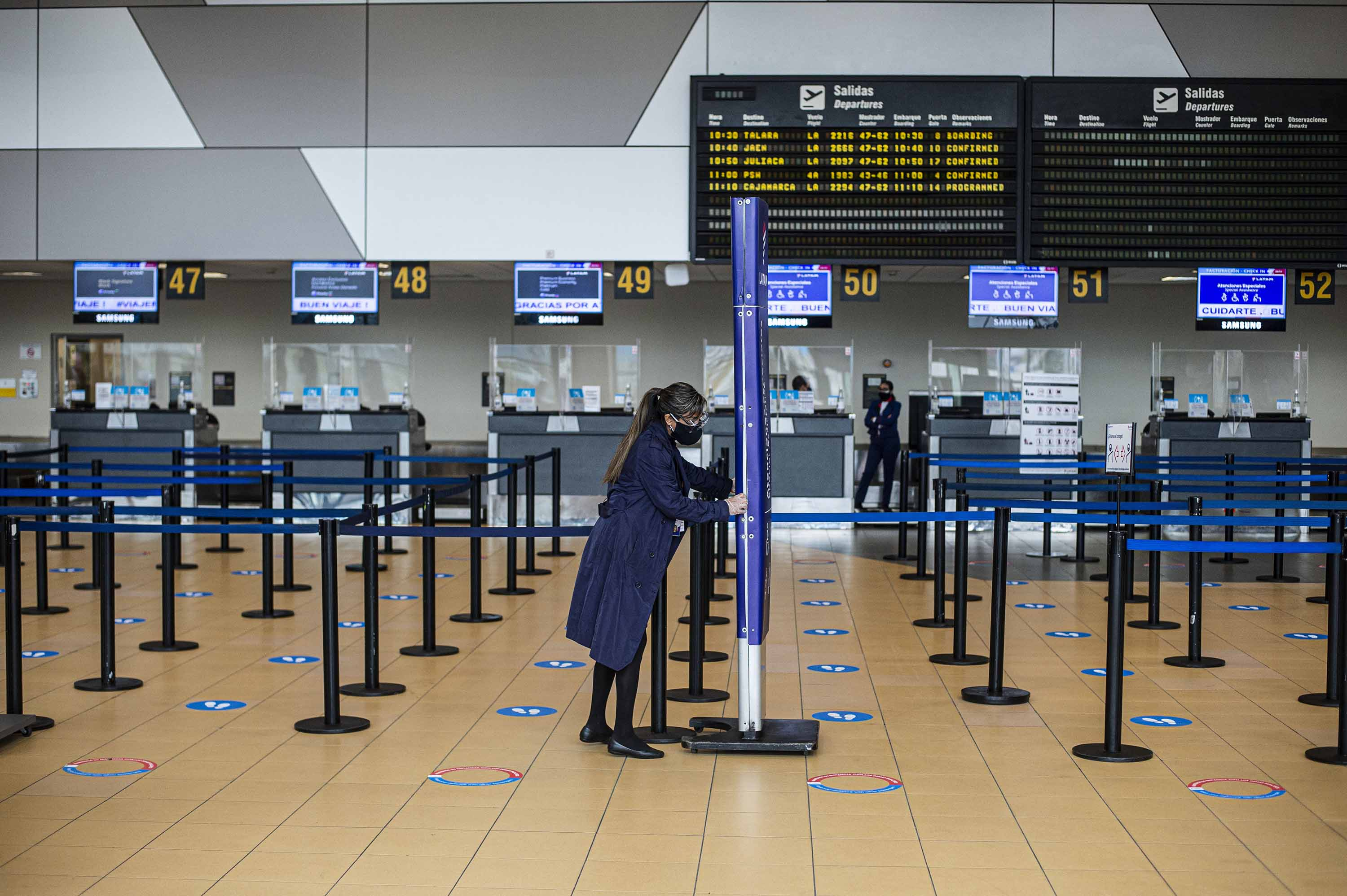 An airport worker is seen at the Jorge Chavez international airport in Lima, Peru, on July 17.