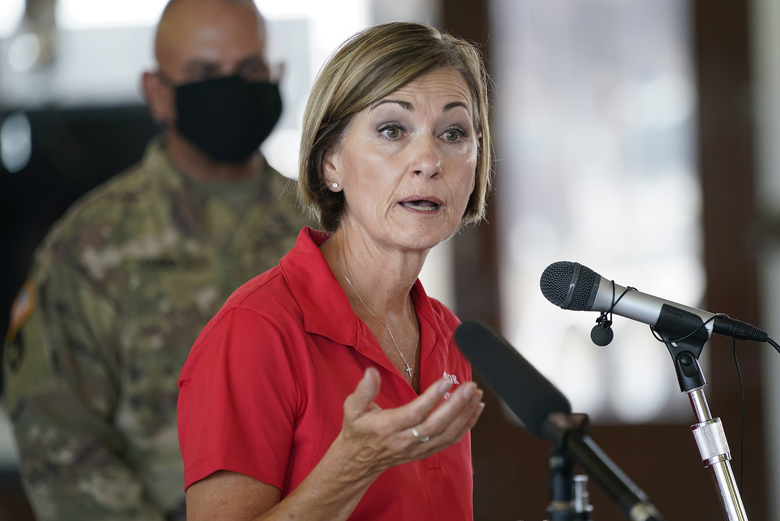 In this Friday, Aug. 14 photo, Iowa Gov. Kim Reynolds speaks during a news conference, in Cedar Rapids, Iowa.