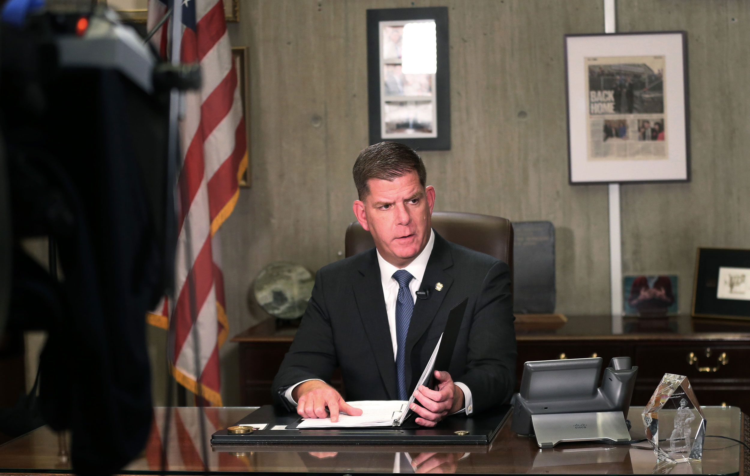 Boston Mayor Martin Walsh prepares to give a televised address from his office at Boston City Hall on March 17.