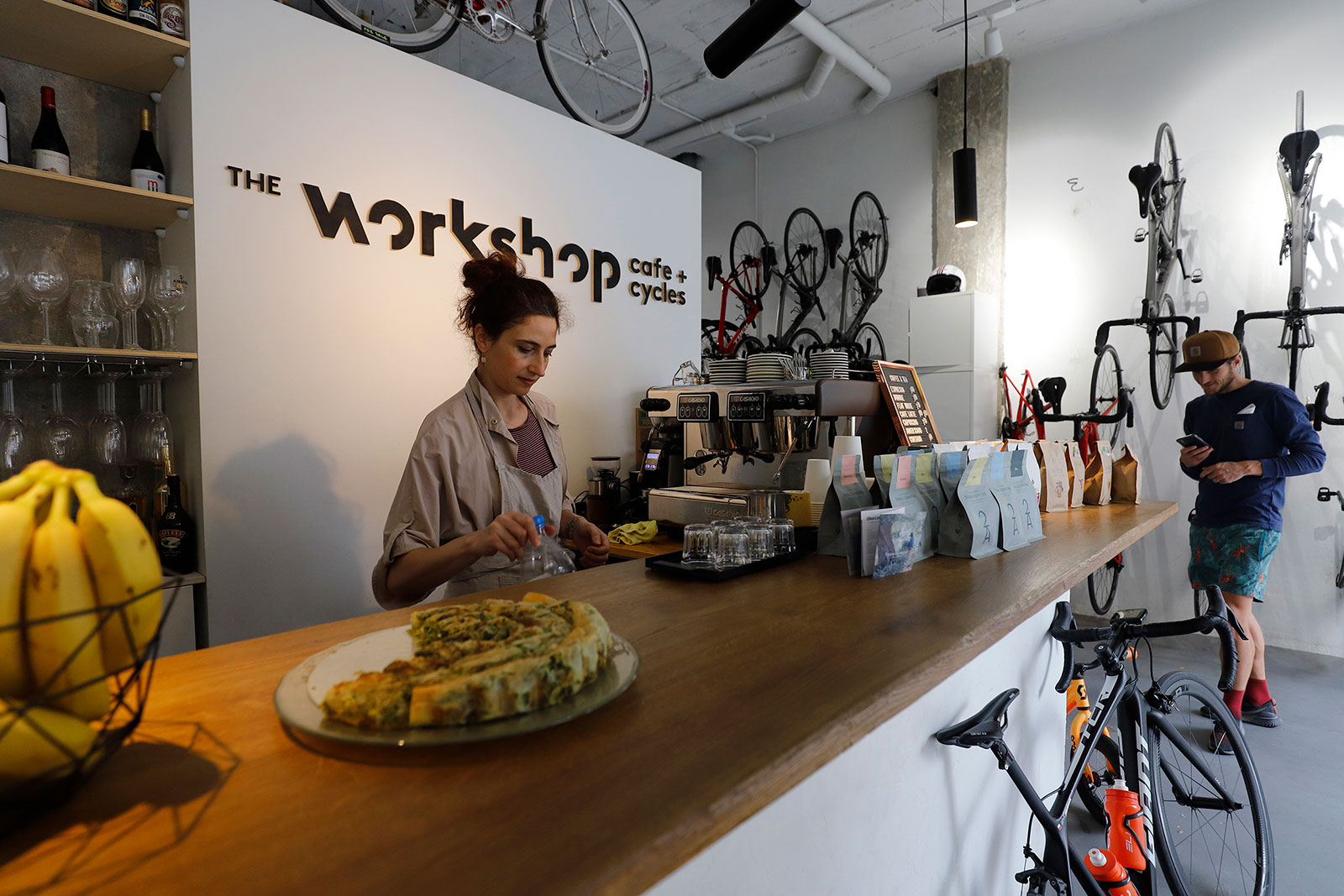 Employees at the Cafe + Cycles restaurant in Palm de Mallorca, Spain, prepare the interior for reopening.