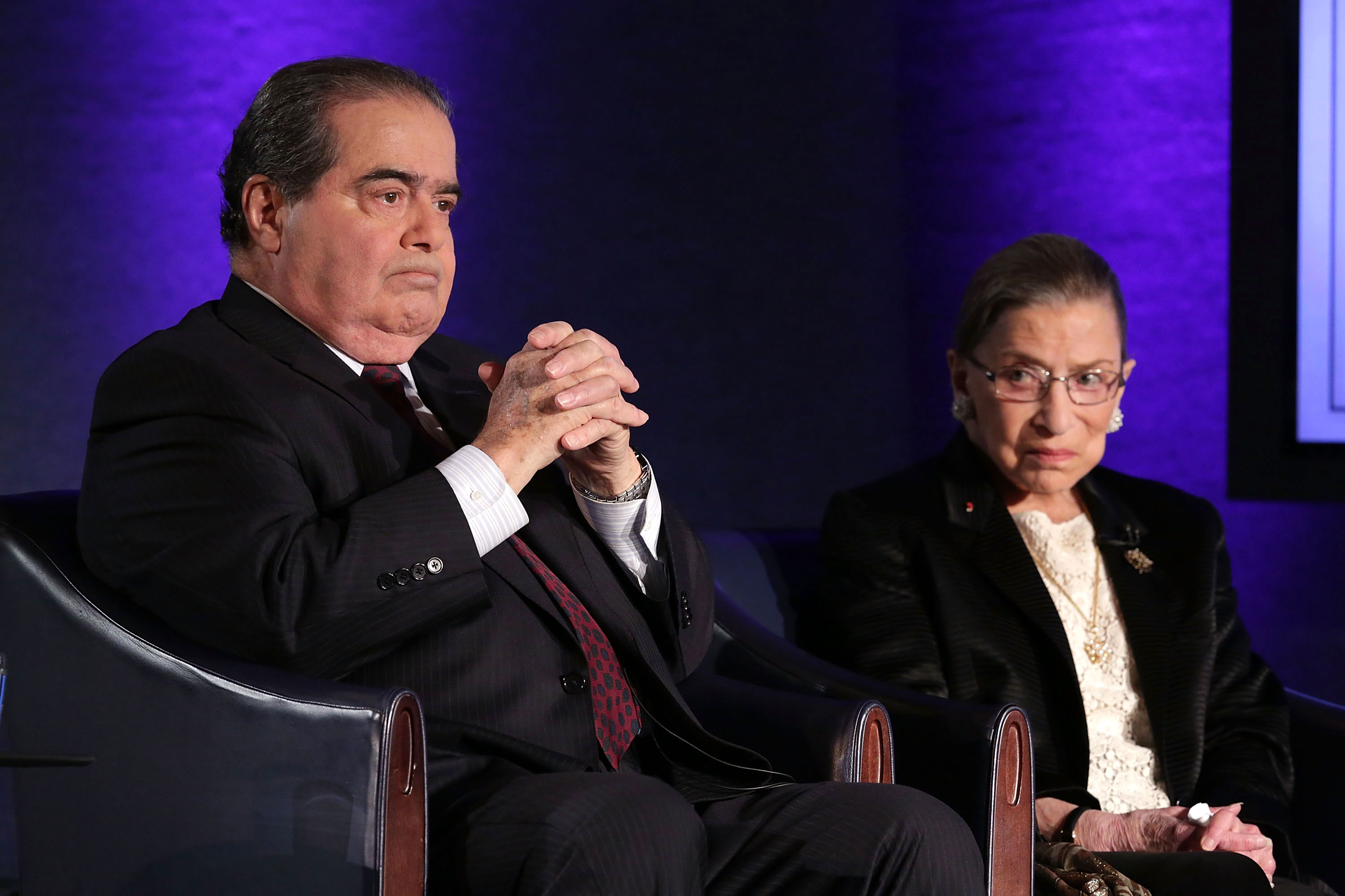 "Supreme Court Justices Antonin Scalia  and Ruth Bader Ginsburg wait for the beginning of the taping of ""The Kalb Report"" in Washington, DC, in 2014."