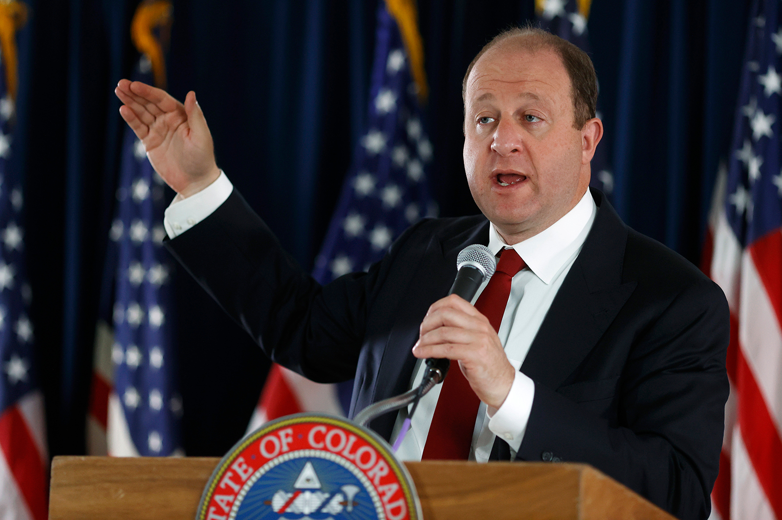 Colorado Gov. Jared Polis speaks during a news conference in Denver, on June 9.