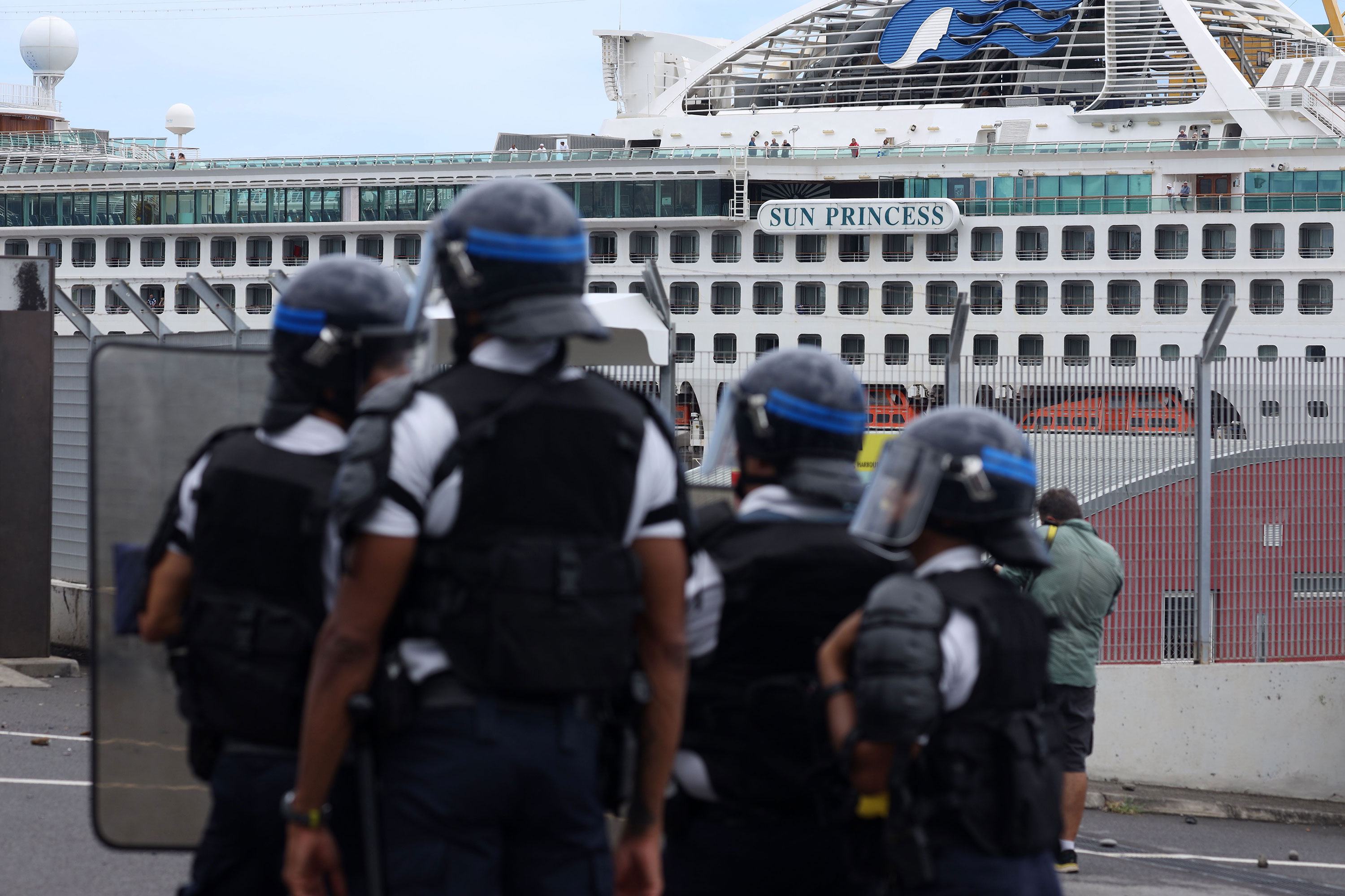 French police officers face demonstrators in Le Port on the Indian Ocean island of La Reunion on March 1.