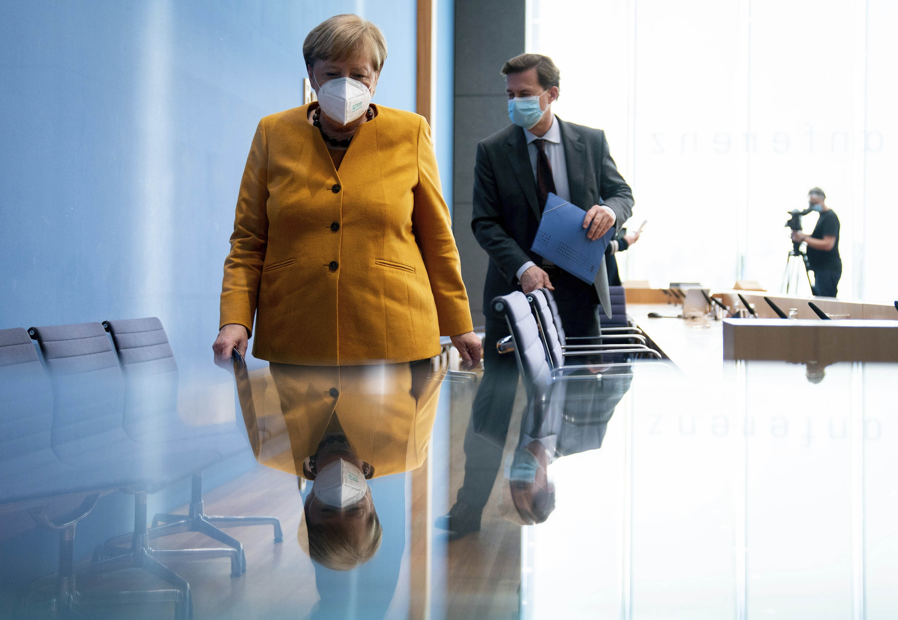 German Chancellor Angela Merkel leaves with spokesmen Steffen Seibert after a news conference in Berlin, on November 2.